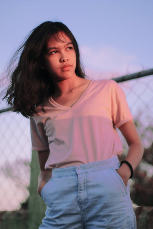 Selective Focus Photography of Woman in Pink Shirt Standing