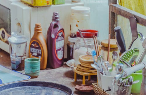 White Ceramic Mug Beside Brown Wooden Bowls