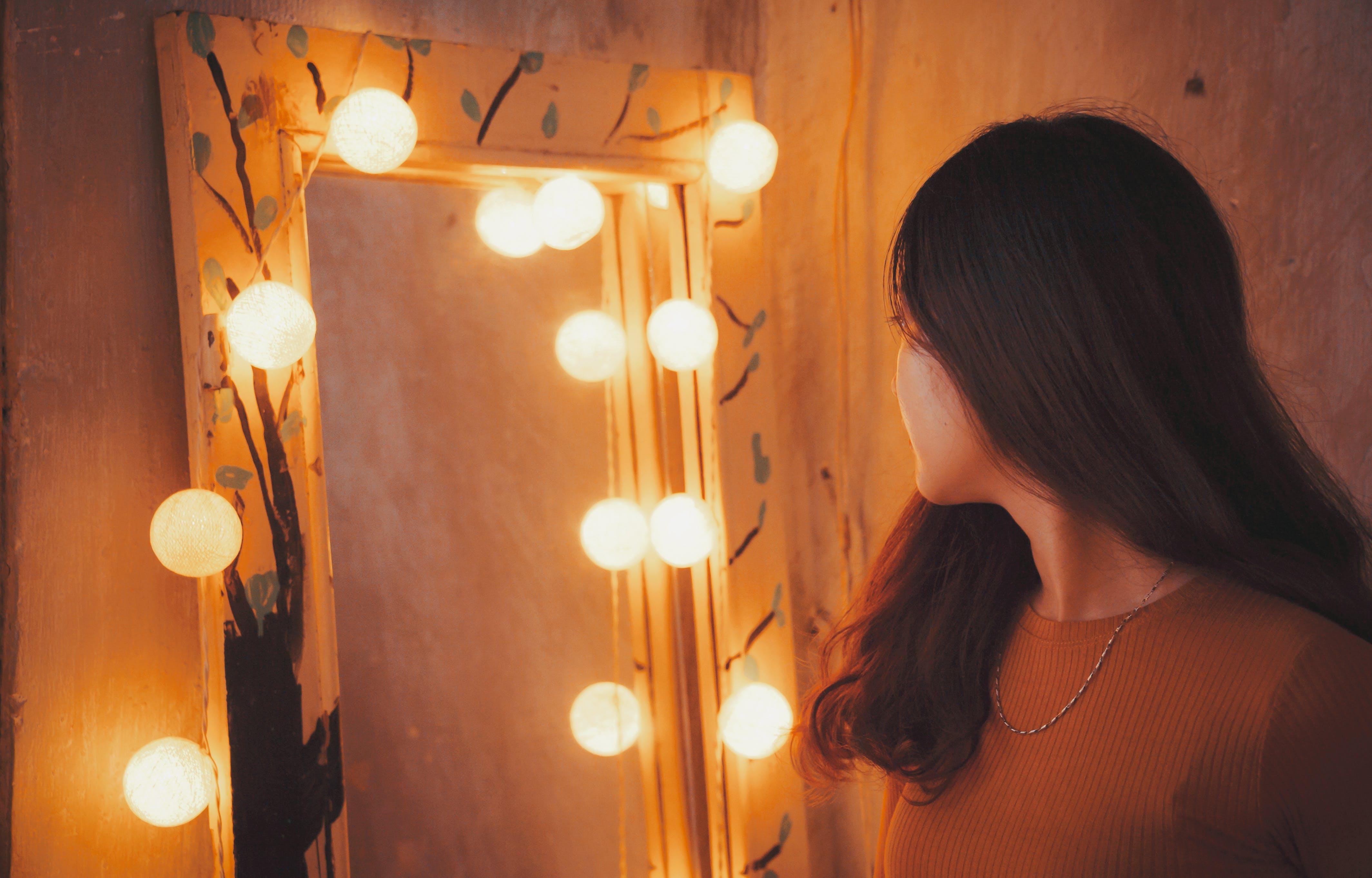 Woman Facing Vanity Mirror