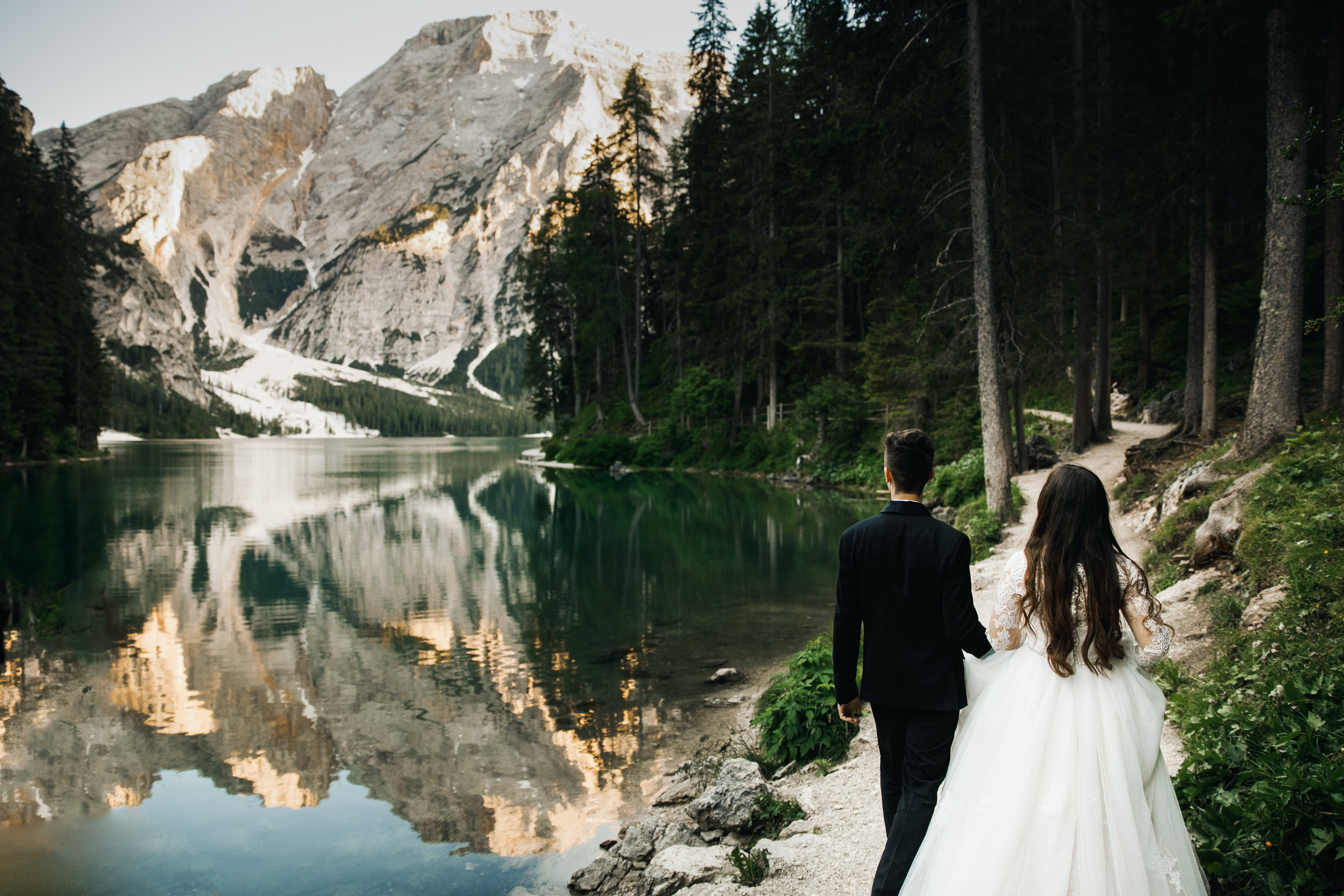 Newly Wed Couple Walking Near Lake