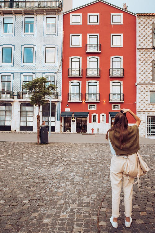 Woman Taking Photo of Buildings