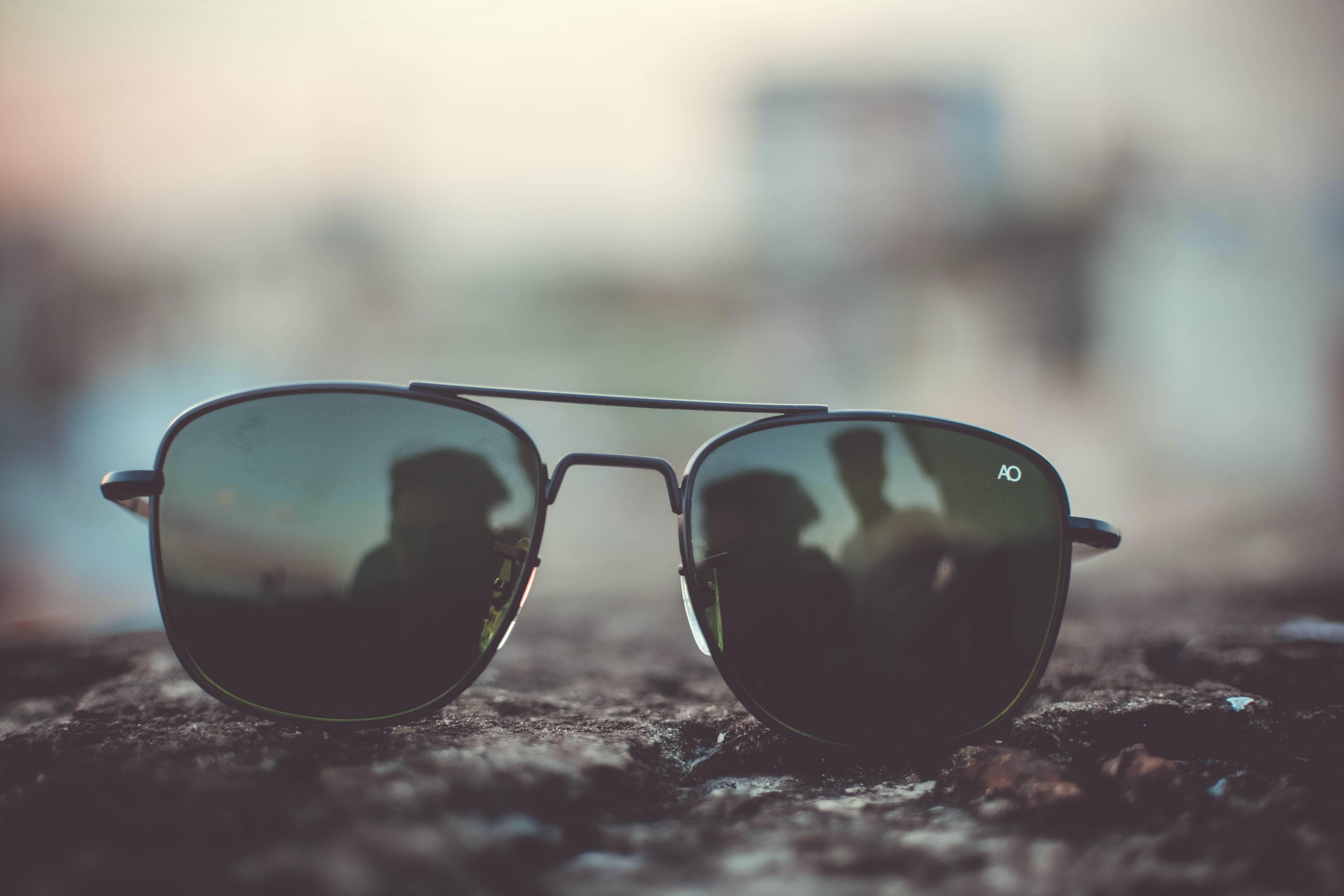 Focus Photo of Black Aviator-style Sunglasses on Surface
