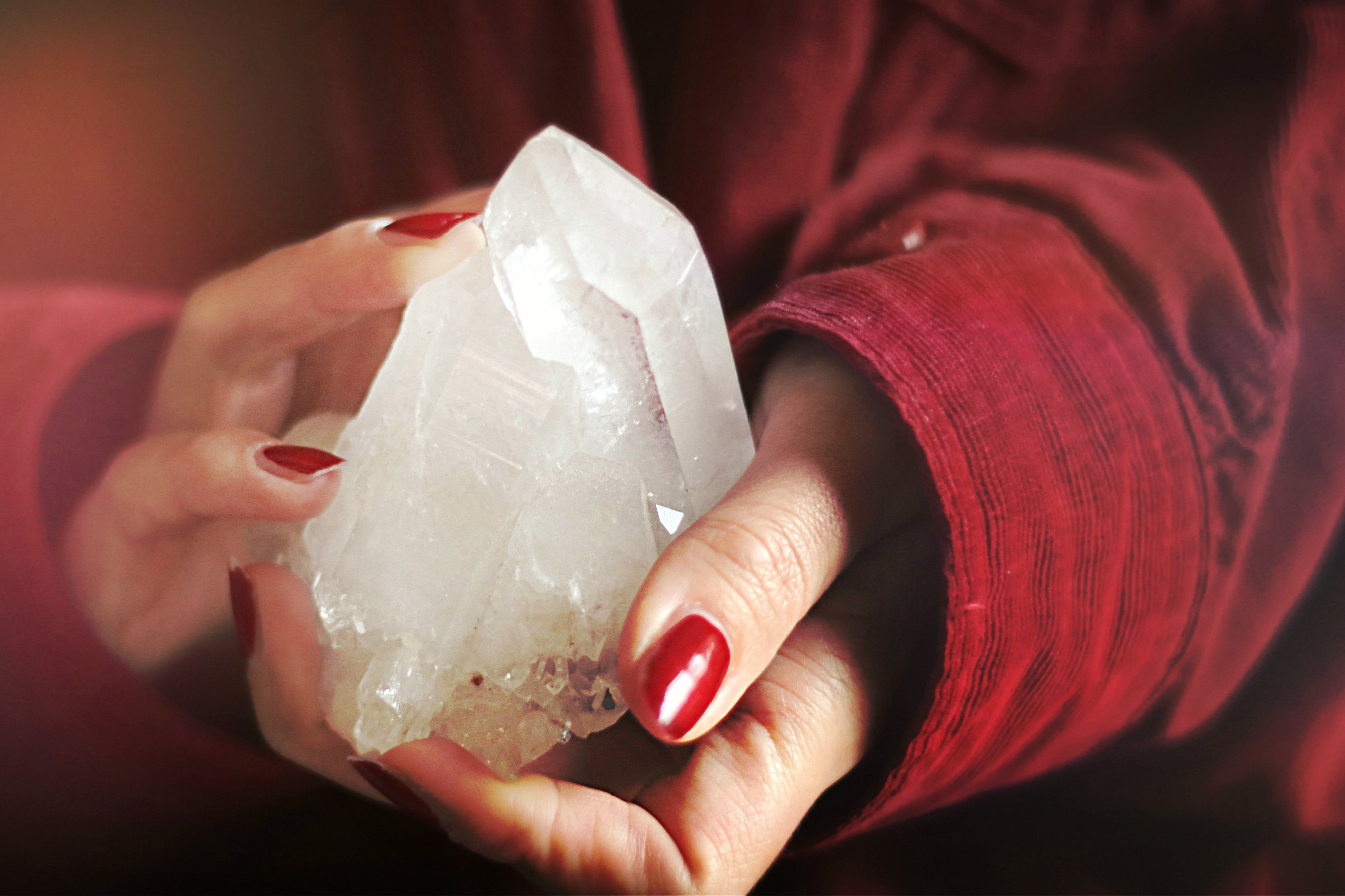 Close-Up Photo of Person Holding Crystal Stone