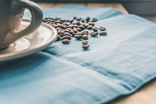 Black Coffee Beans on Blue Textile
