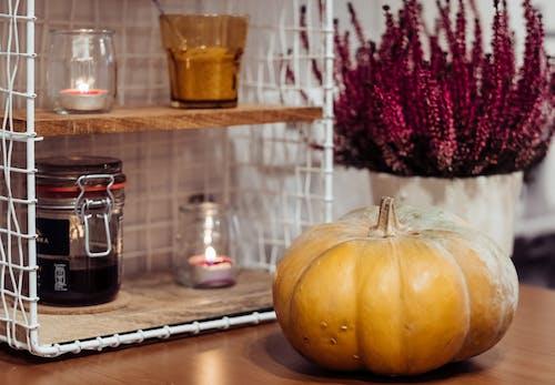 Photos gratuites de à l'intérieur, bougies, centrale, citrouille