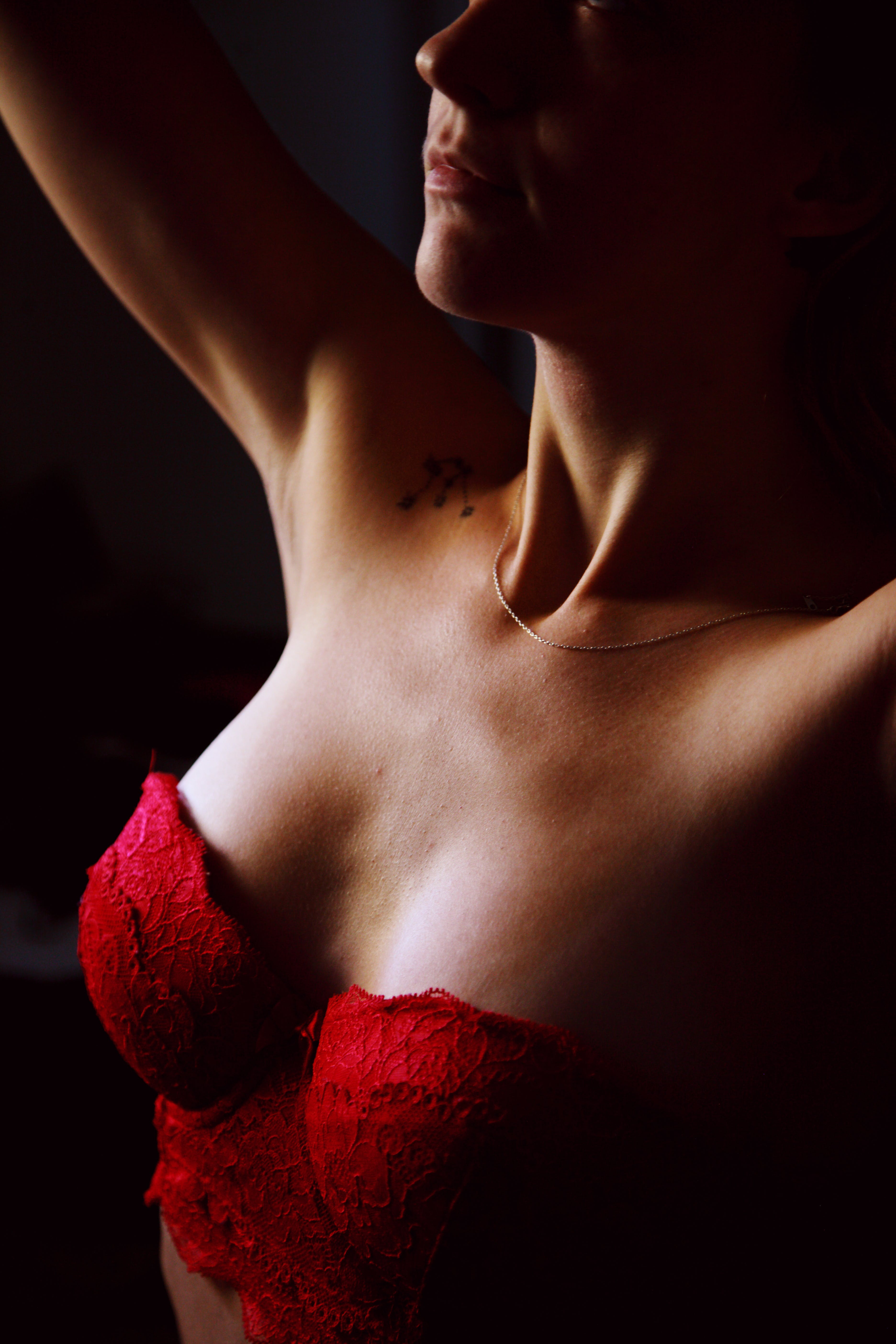 Close-up Photo of Woman Wearing Red Bralette