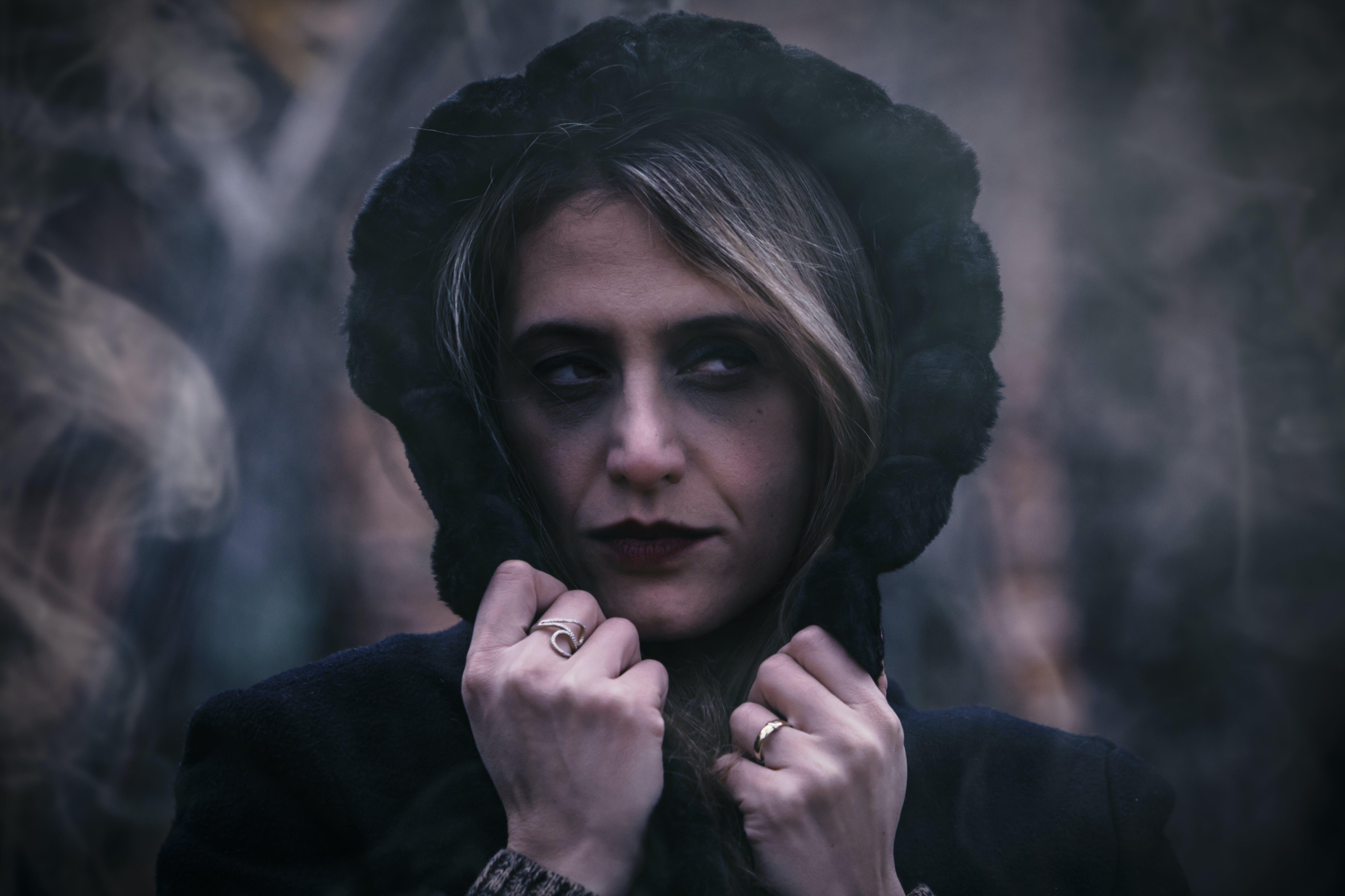Close-Up Photo of Woman Wearing Black Hood