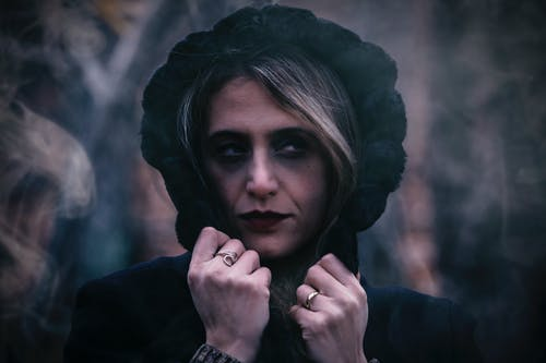 Close-Up Photo of Woman Wearing Black Hood