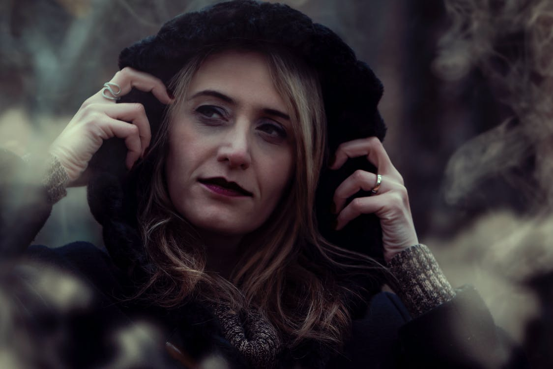 Close-up Photography of Woman Wearing Black Hooded Jacket