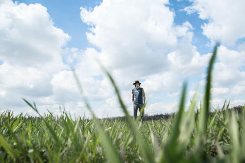Photo of Person Standing On Grass Field