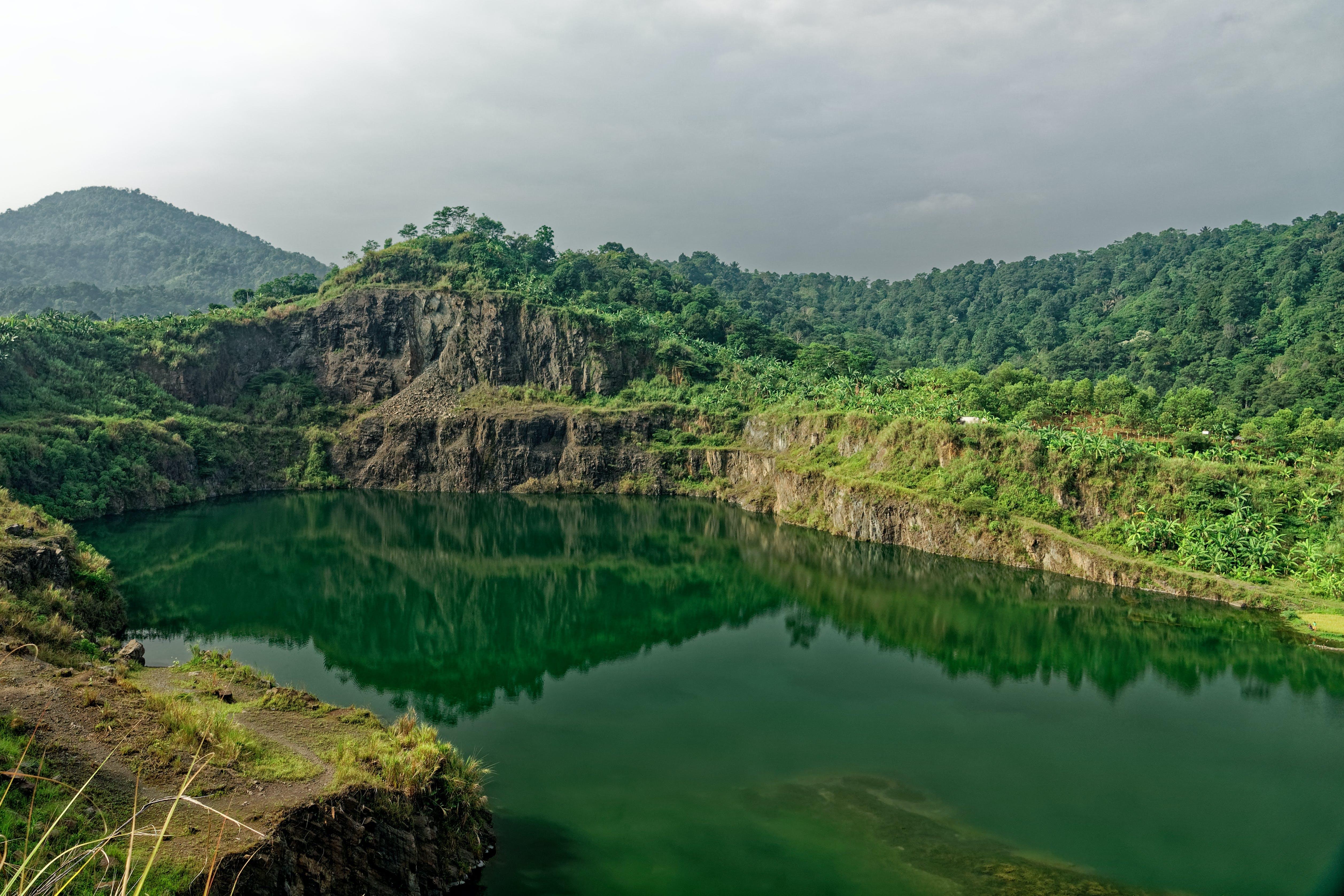 Bird's-eye View of Mountain Beside Body of Water
