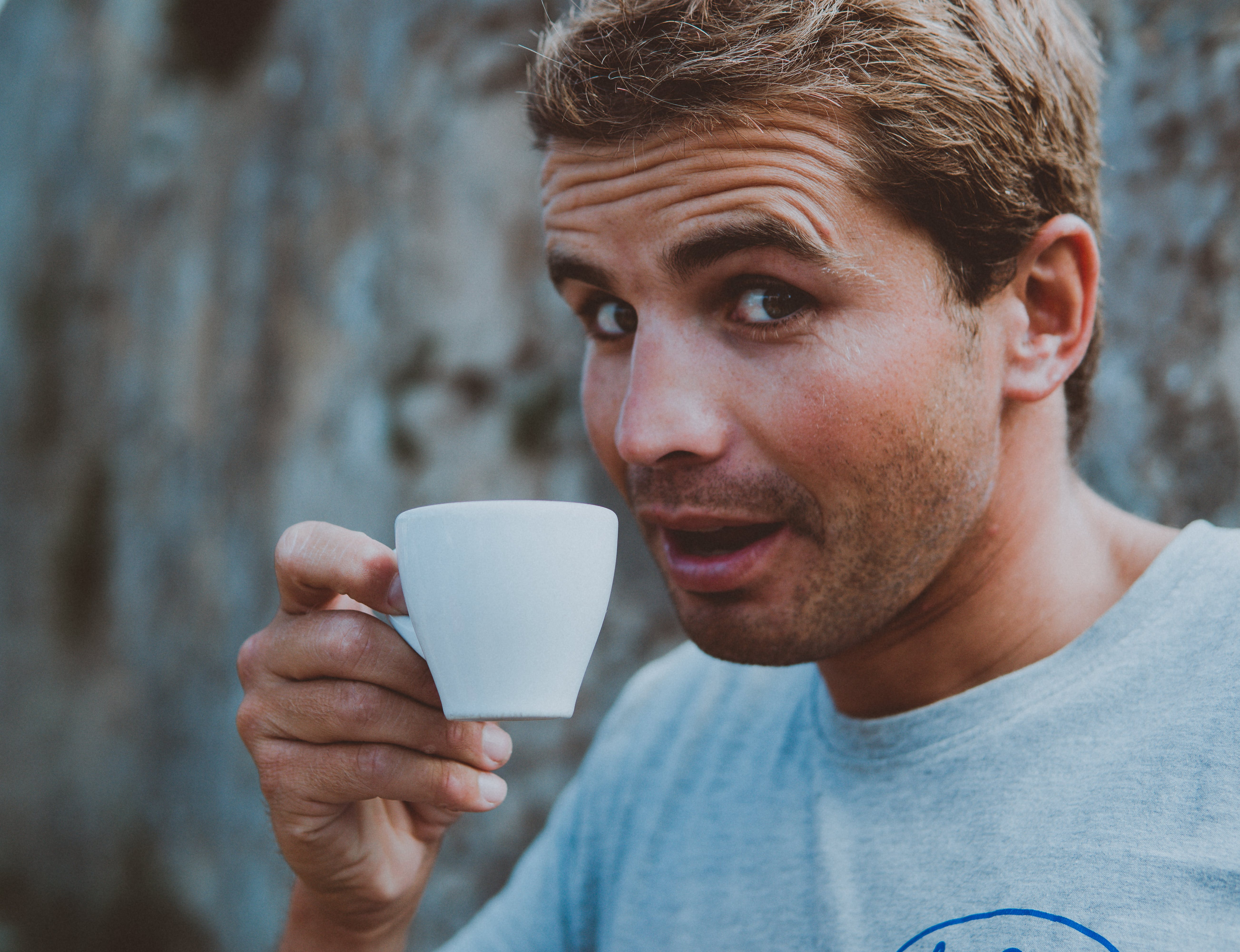 Selective Focus Photography of Man Holding Teacup