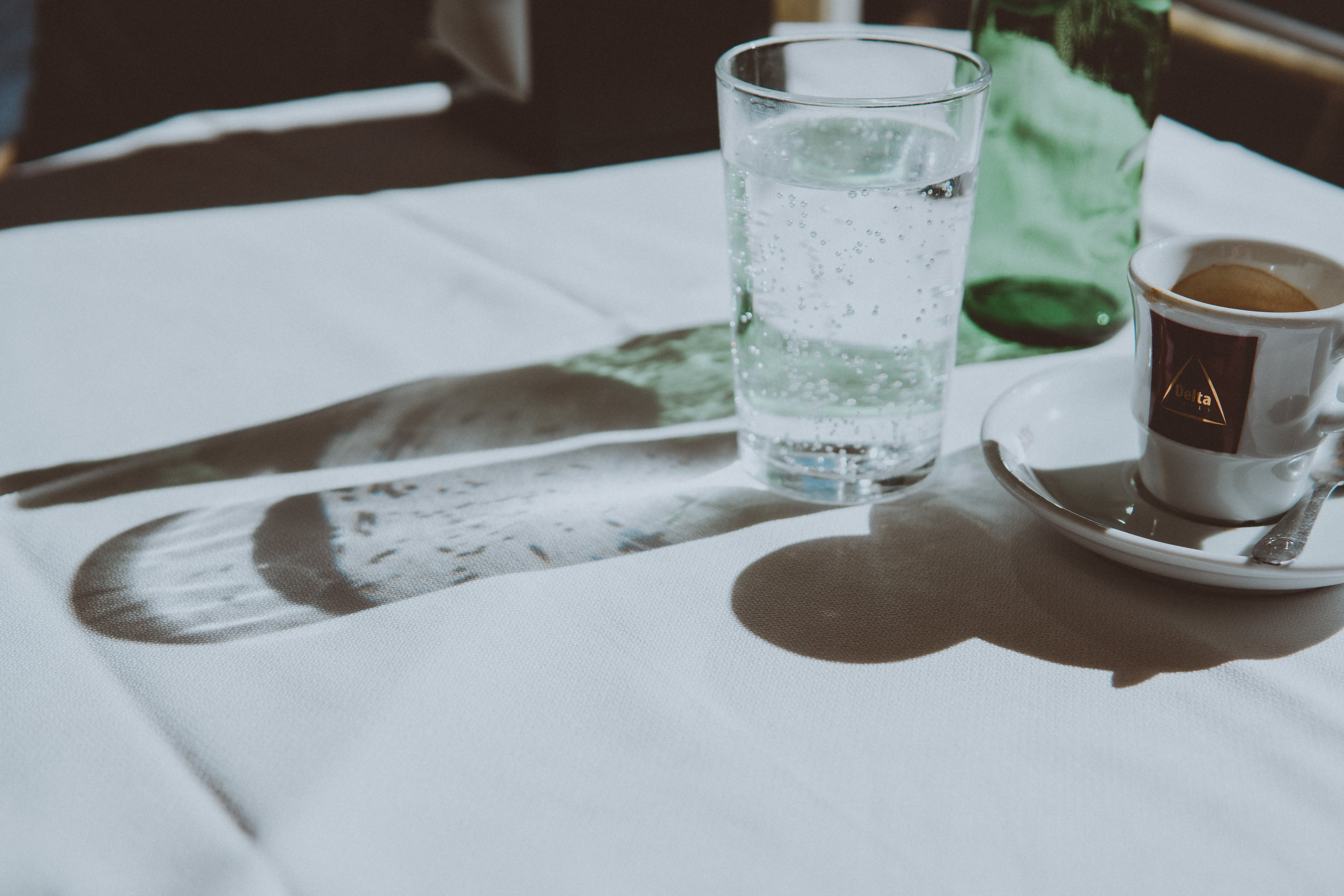 Clear Drinking Glass Beside Teacup