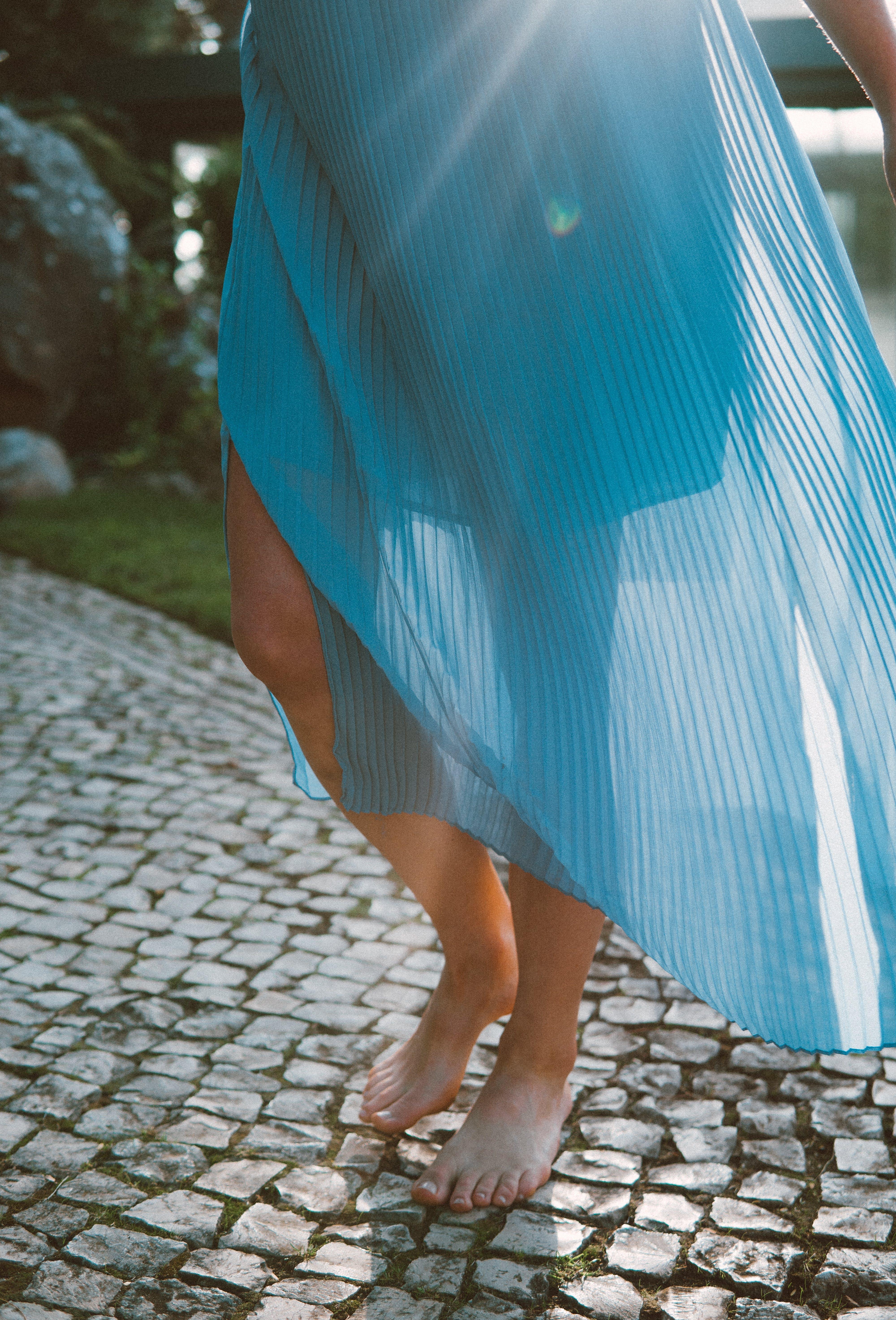 Photo of Woman Wearing Blue Dress