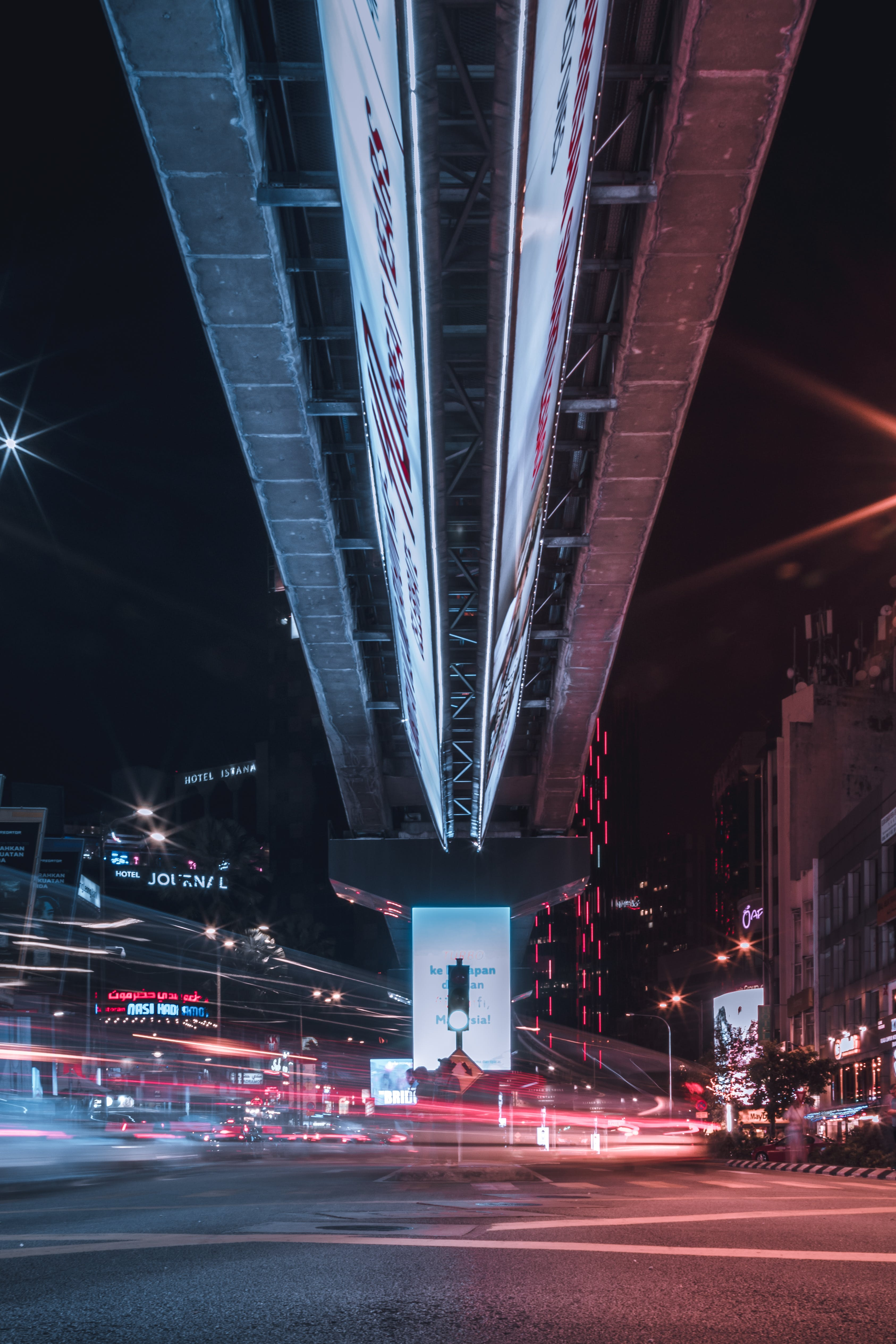 Timelapse Photo of Intersection Under a Bridge