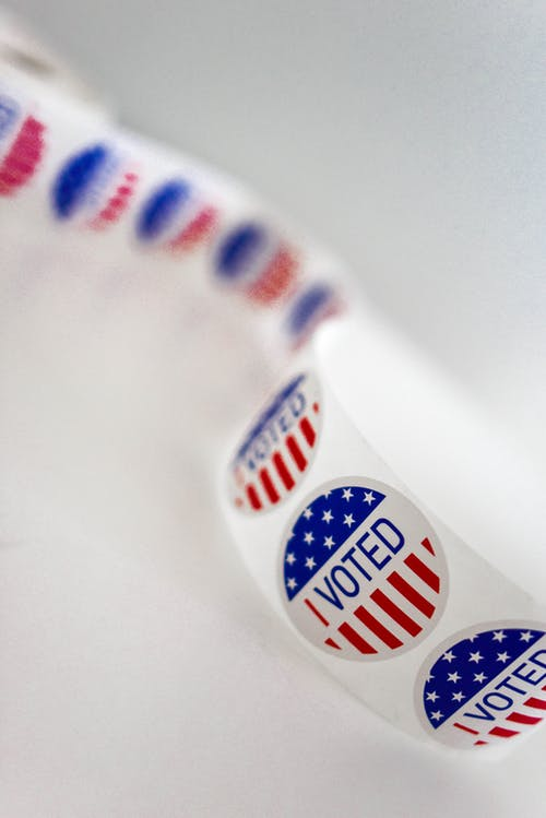 Sticker tape with American flag and I voted text