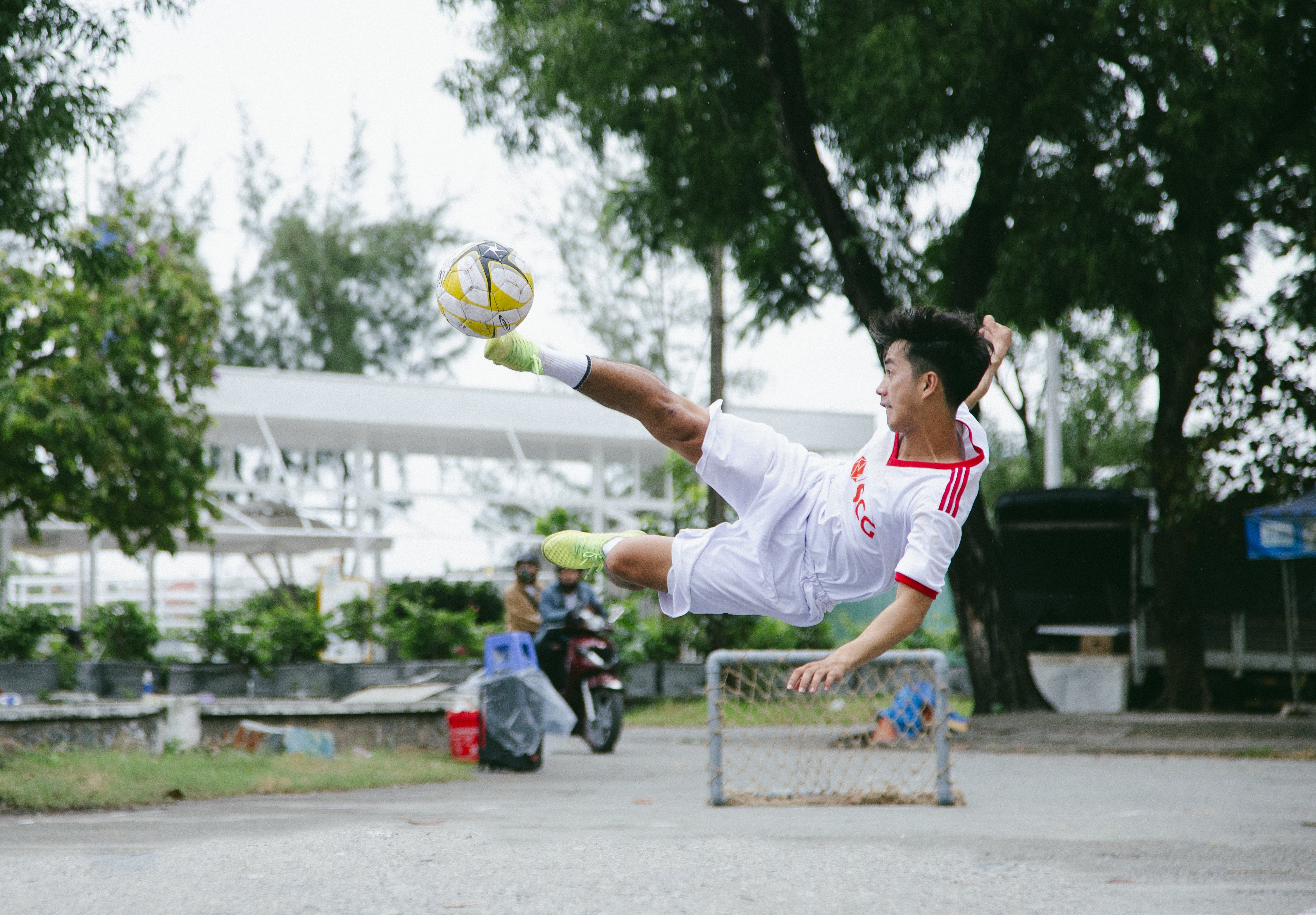 Time Lapse Photography of Soccer Player Jumping Kicking Ball