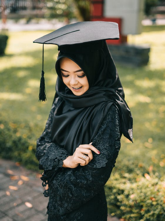 Selective Focus Photography of Woman Wearing Square Academic Cap