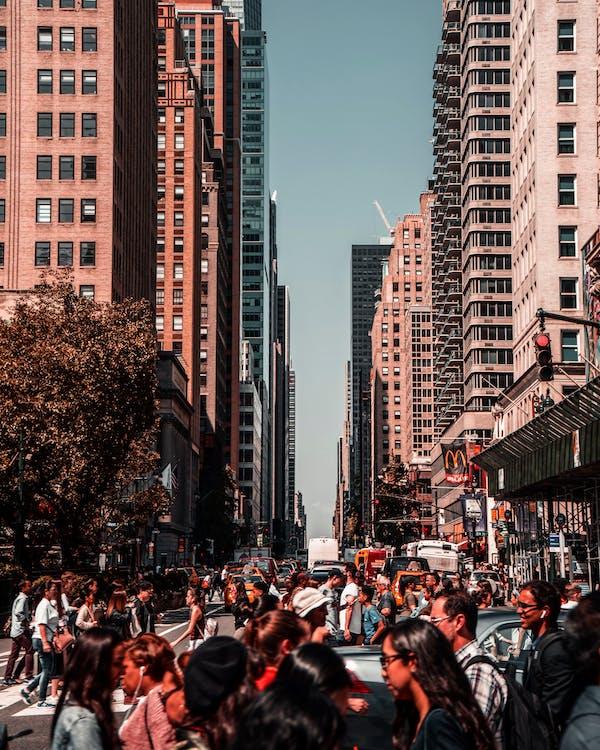 People Walking Near High Rise Buildings