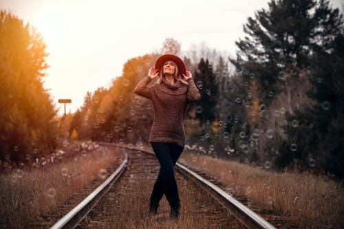 Woman Standing in Railway