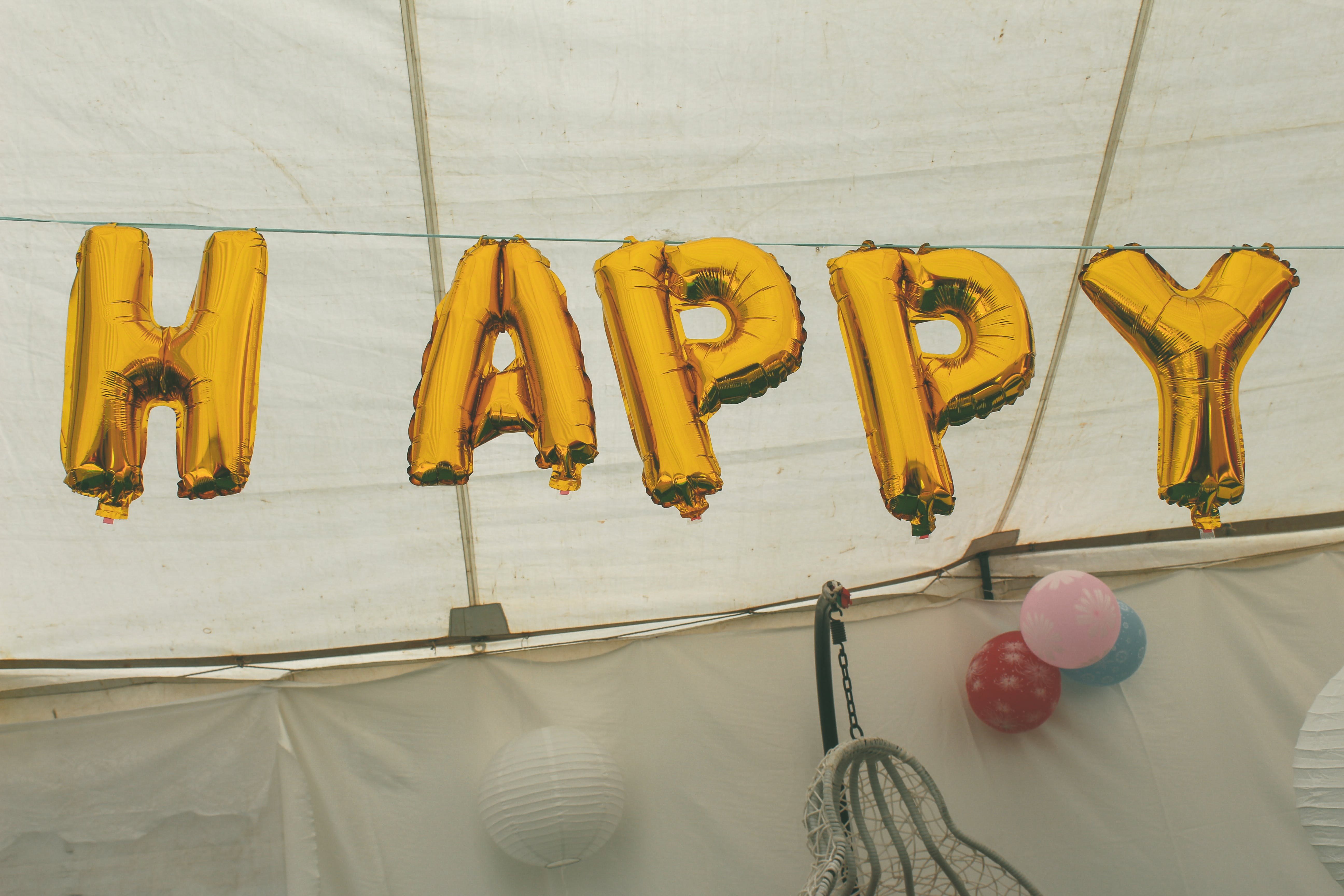 Gold Balloons Hanging On String