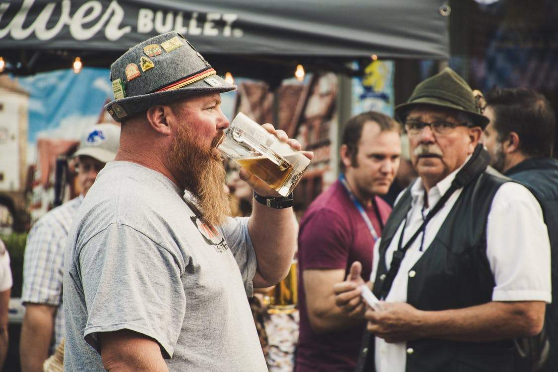 Man Drinking from a Beer Pint
