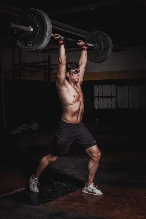 Man Lifting A Barbell
