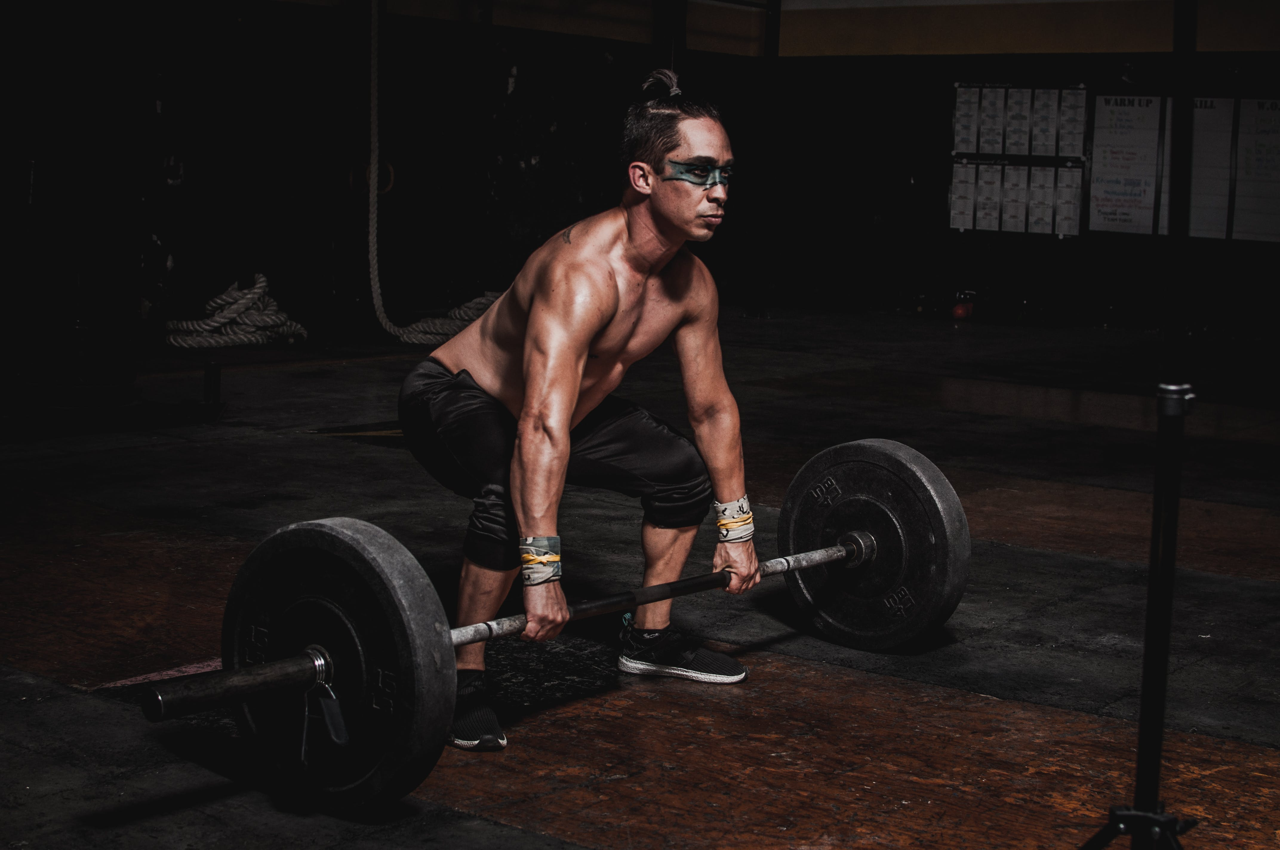 Shirtless Man Lifting Barbell