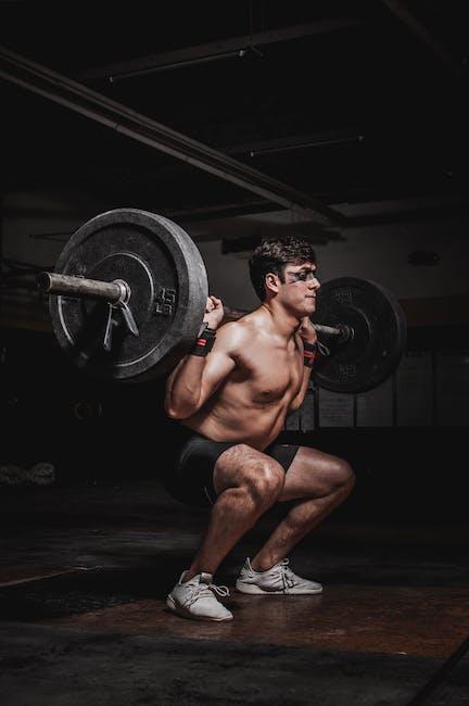 Photo of man lifting barbell