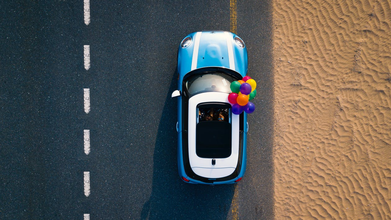 Aerial Photography of Blue Car on Road