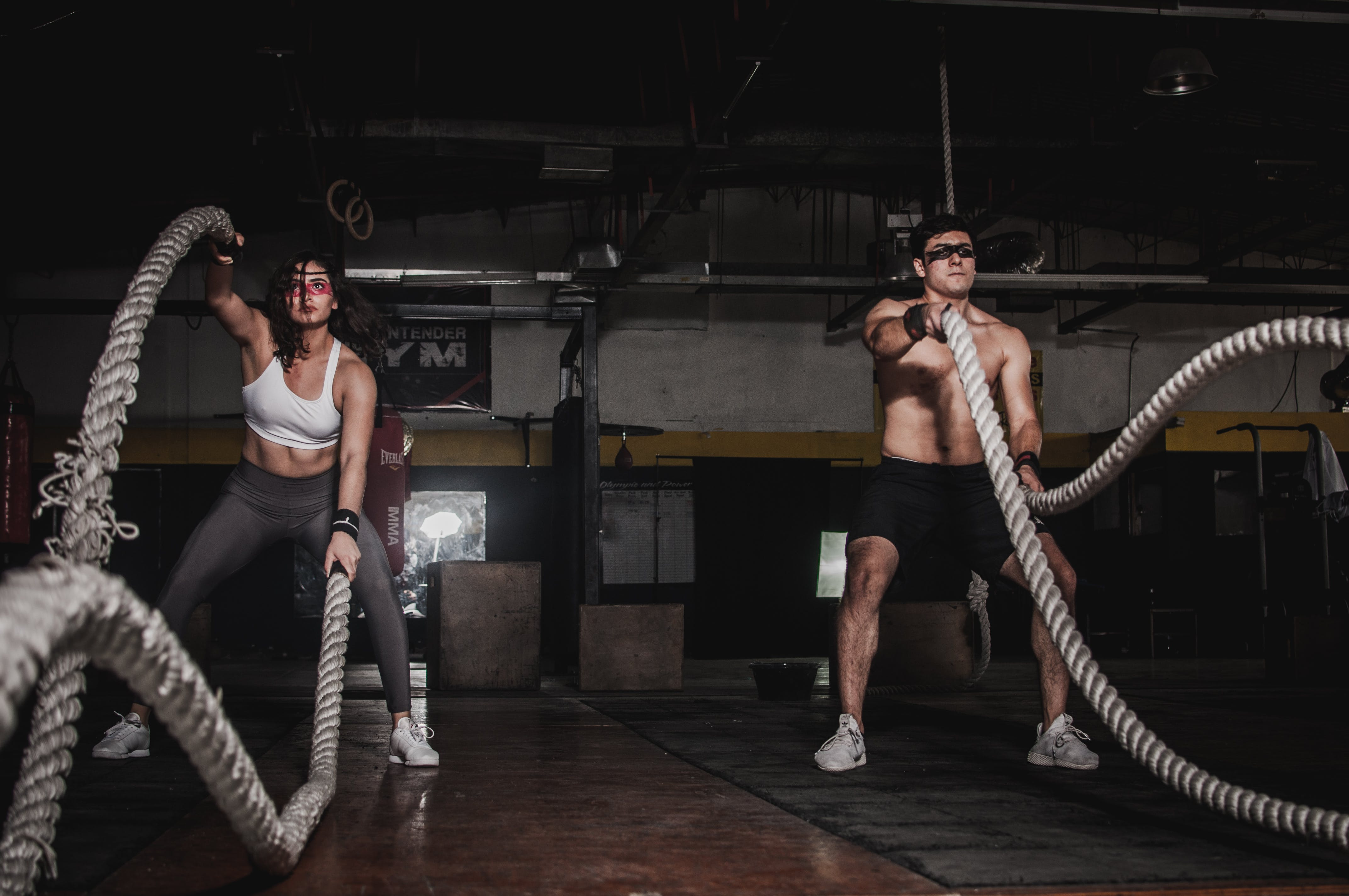 Man And Woman Holding Battle Ropes