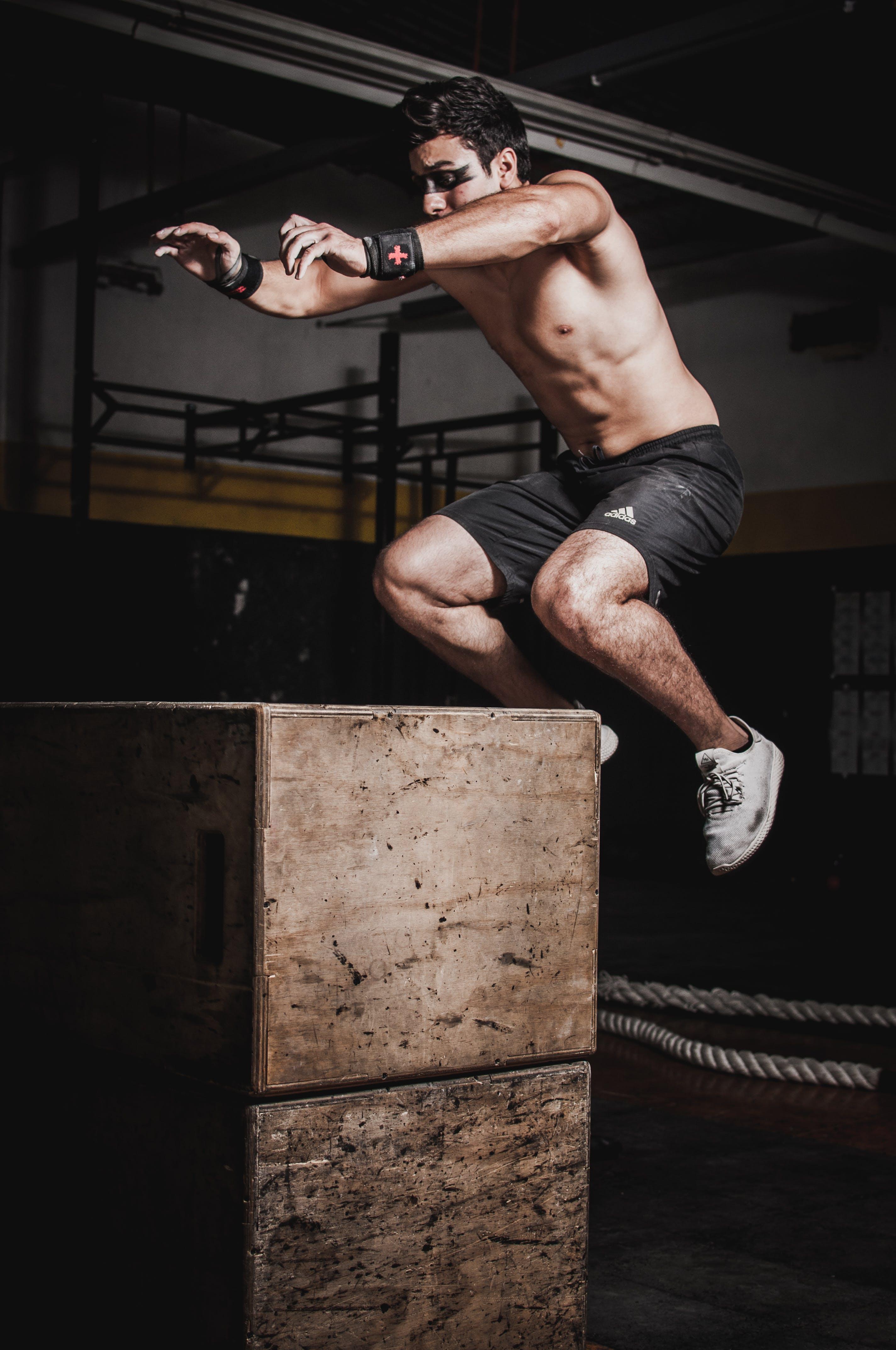 Photo of Man Jumping On Box