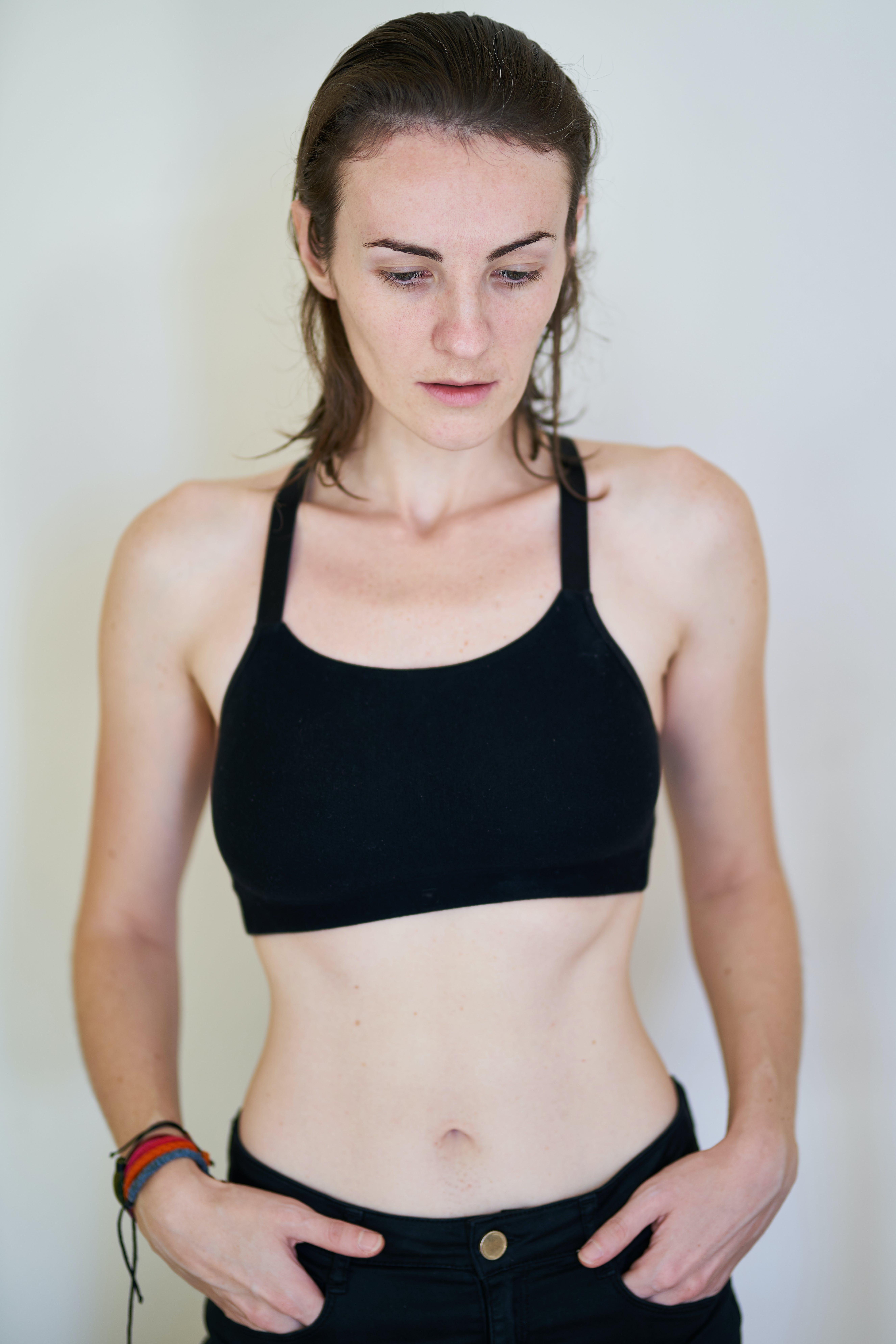Photo of Woman in Black Crop Top