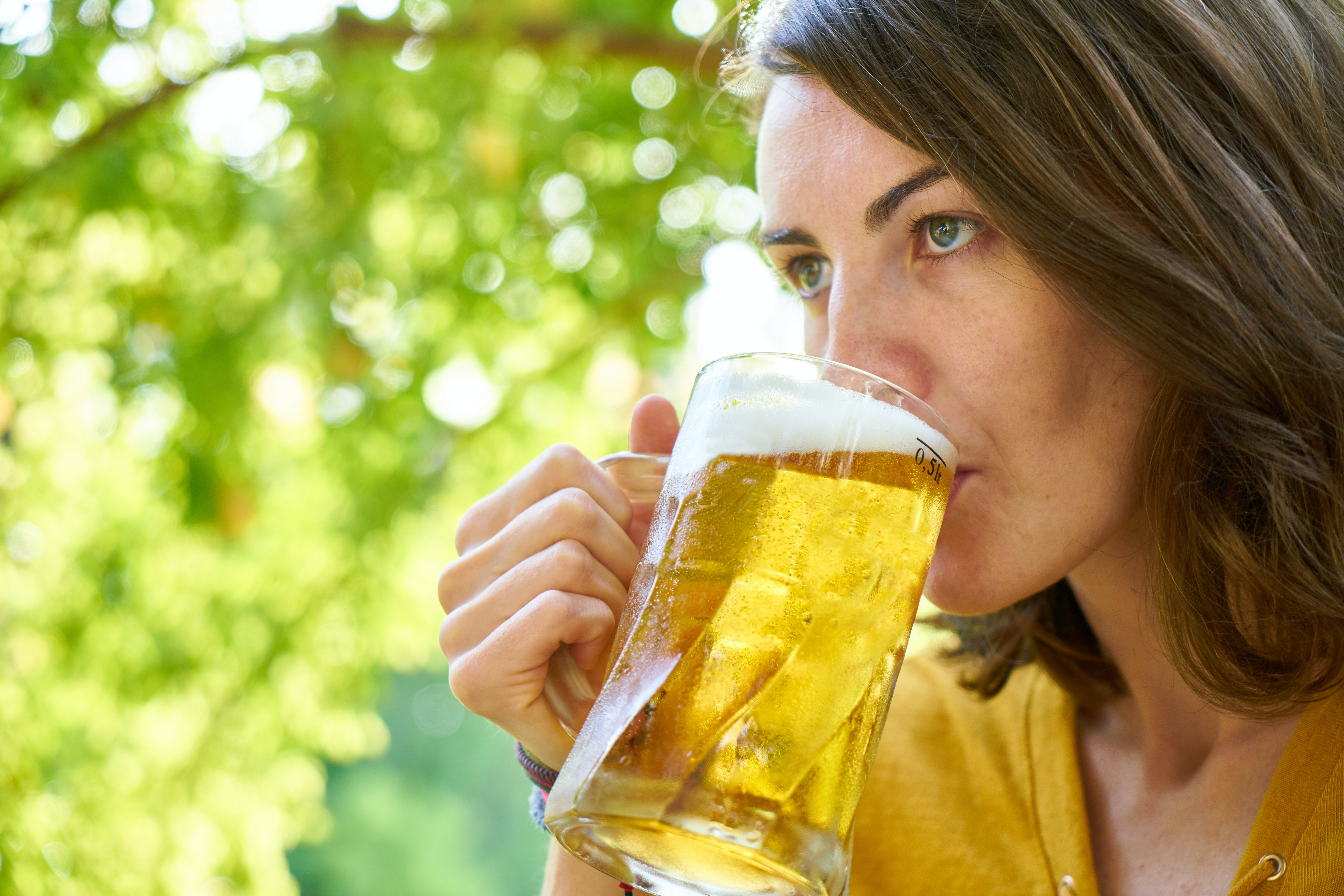Photo of Woman Drinking Beer