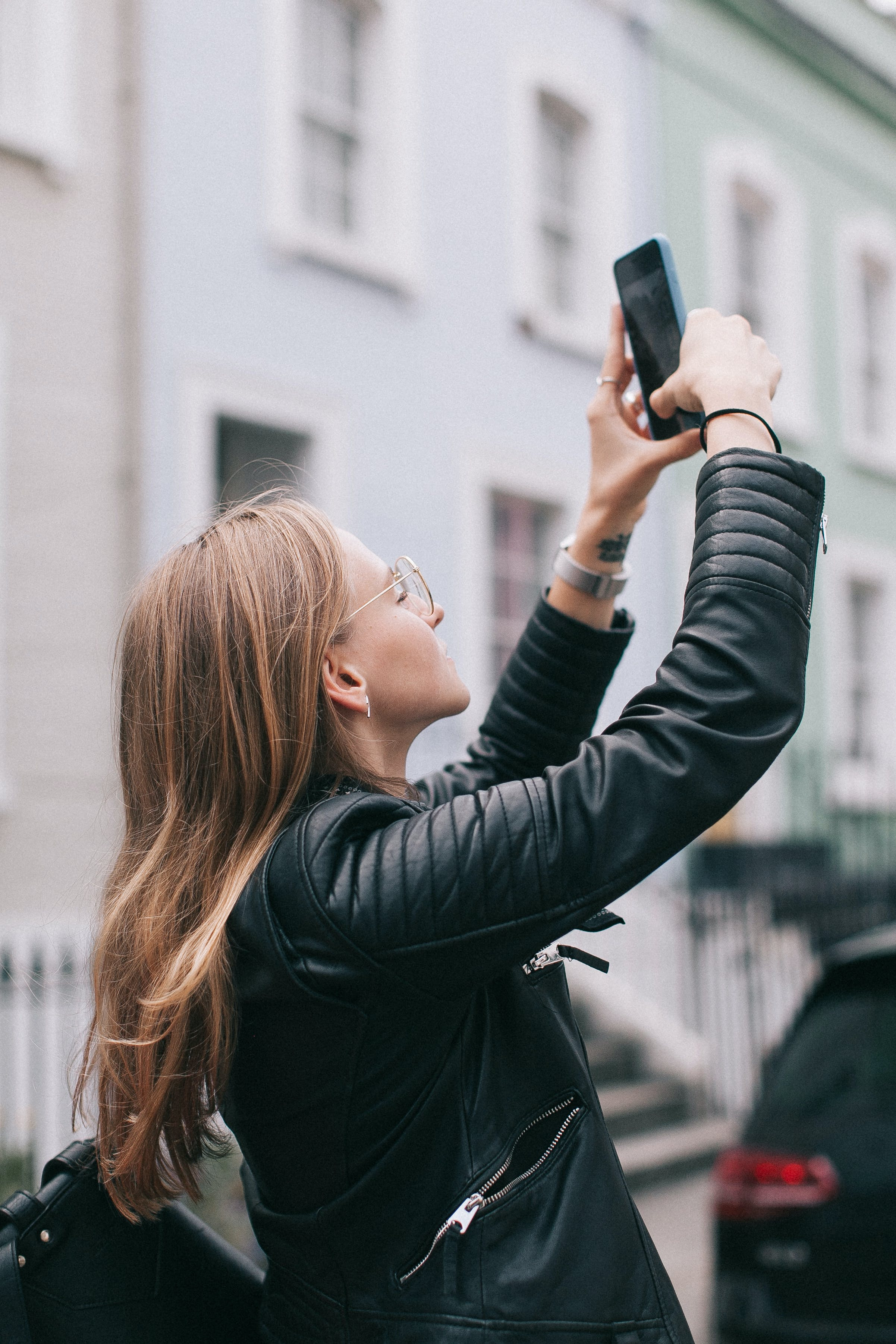 Photo of Woman Taking a Photo with Her Smartphone