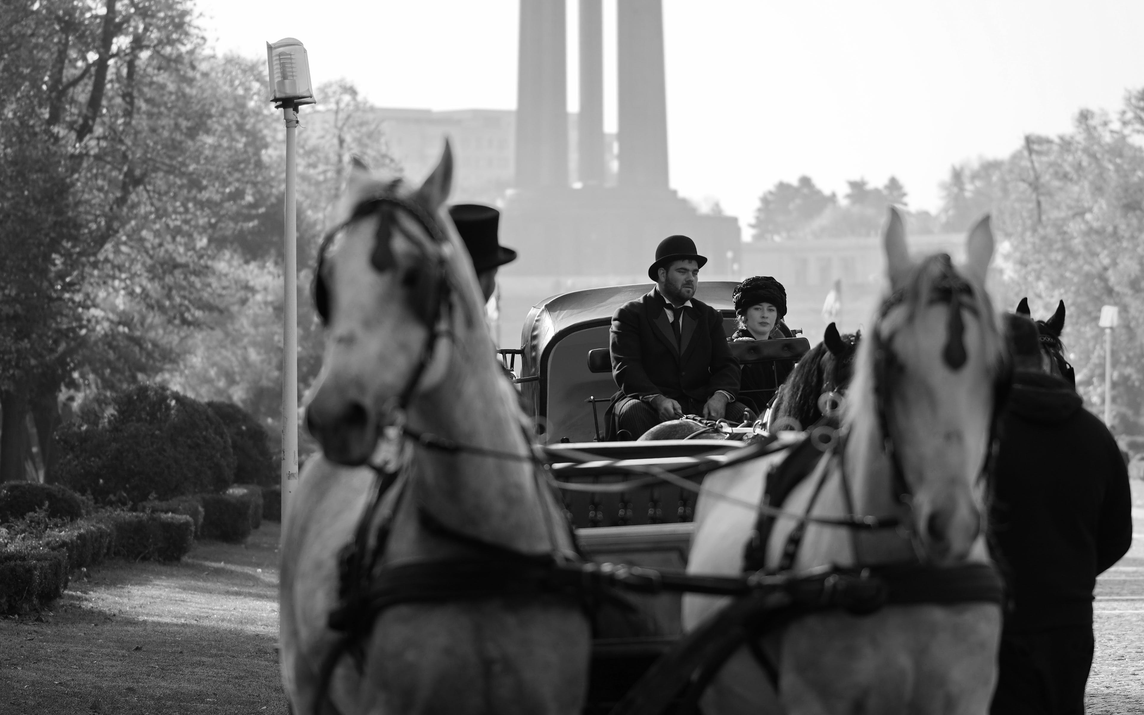Grayscale Photography of Man and Woman Riding Carriage