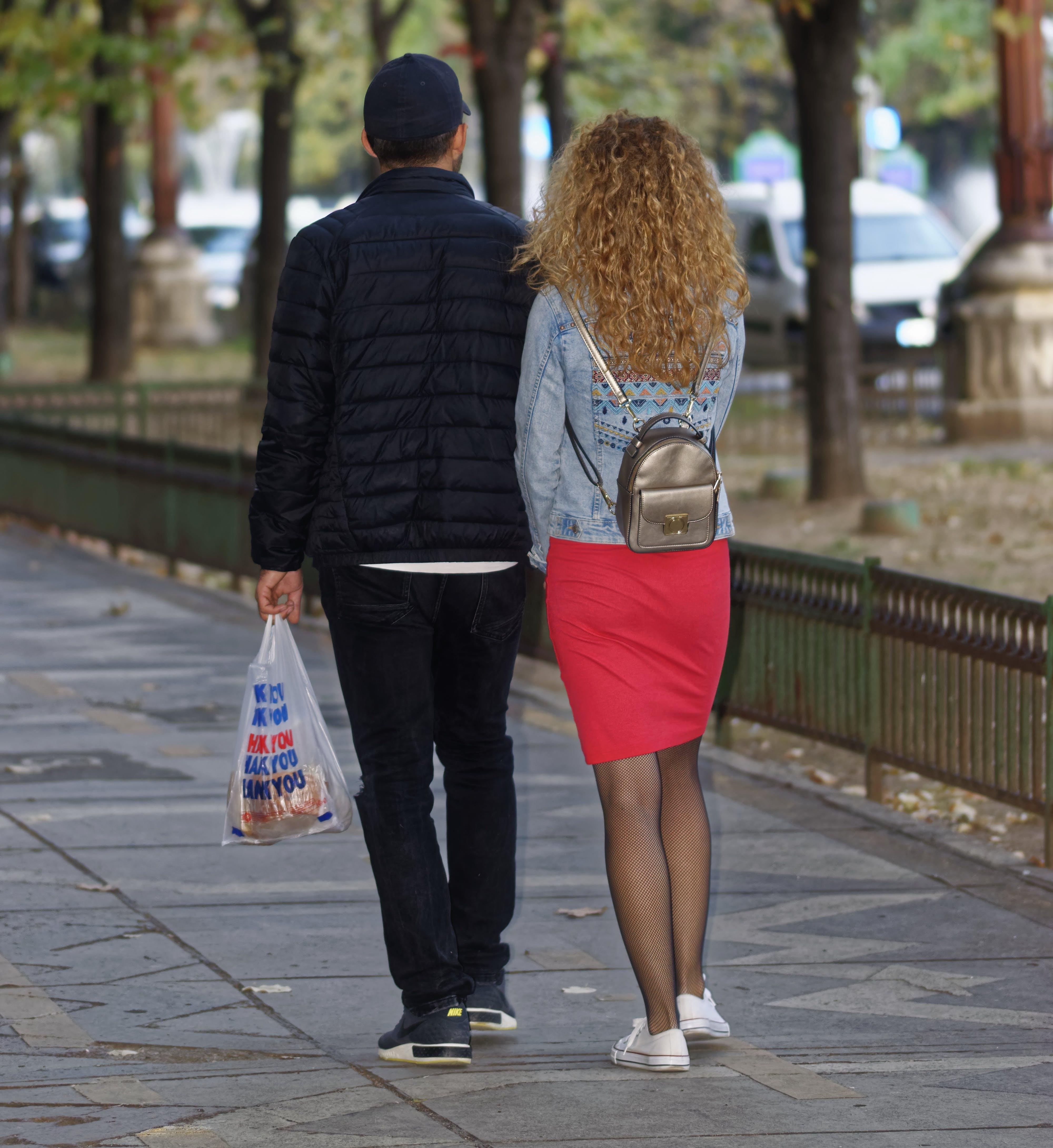 Free stock photo of couple walking, paved walkway, young couple