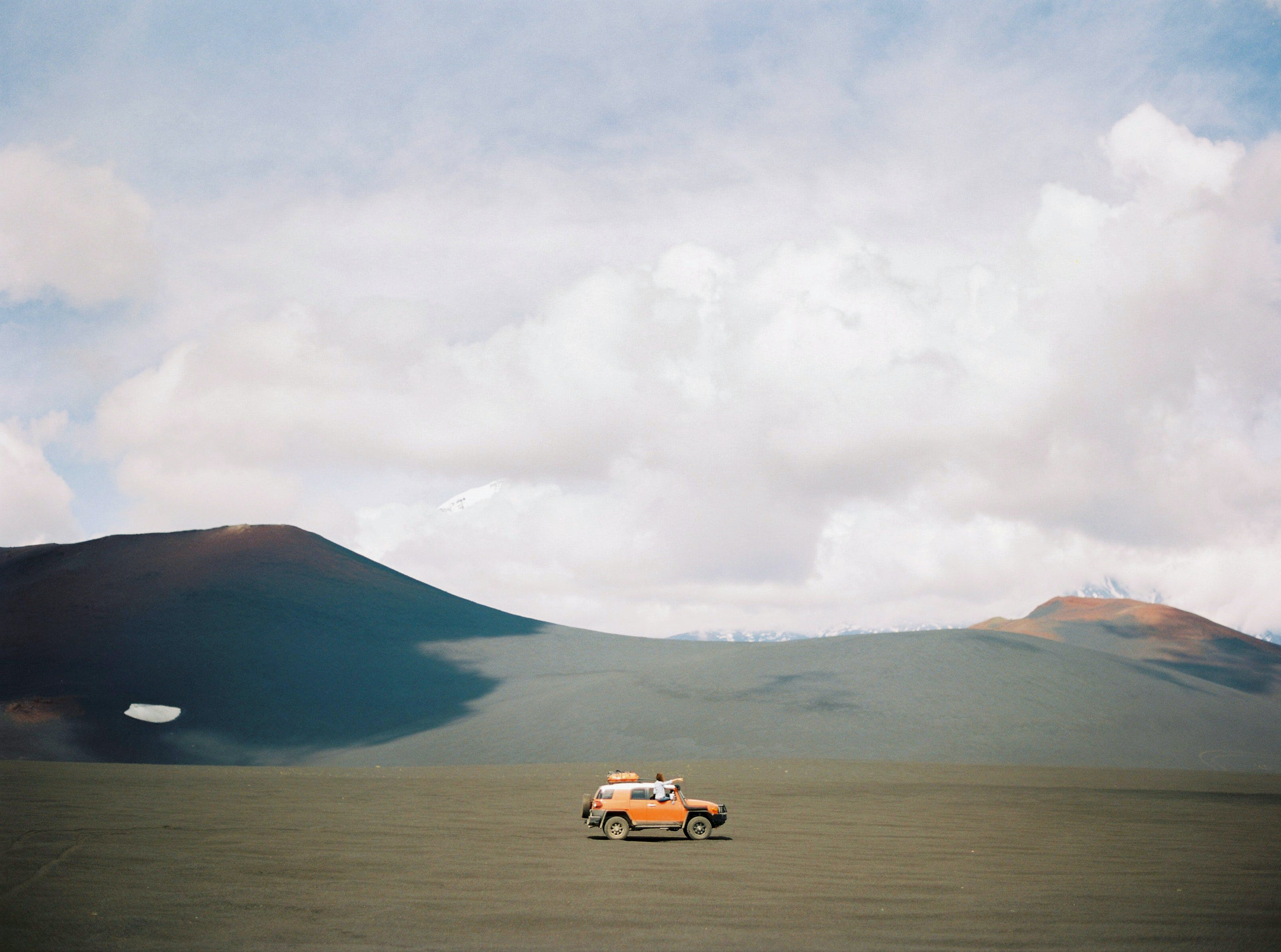 Orange Vehicle on Brown Sand
