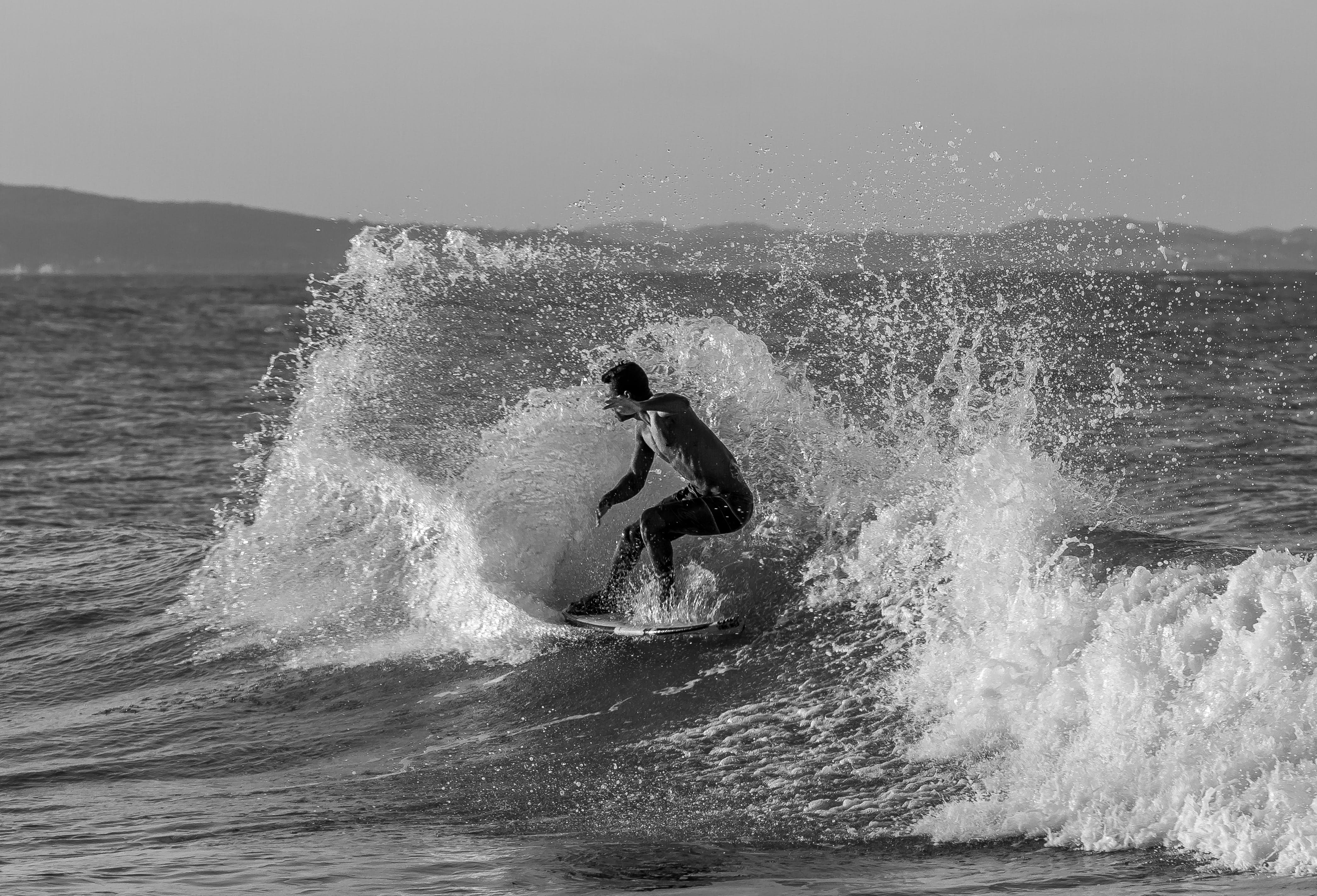 Grayscale Photo of Man Surfing