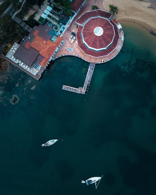 Aerial Photography Of Building Beside Body Of Water