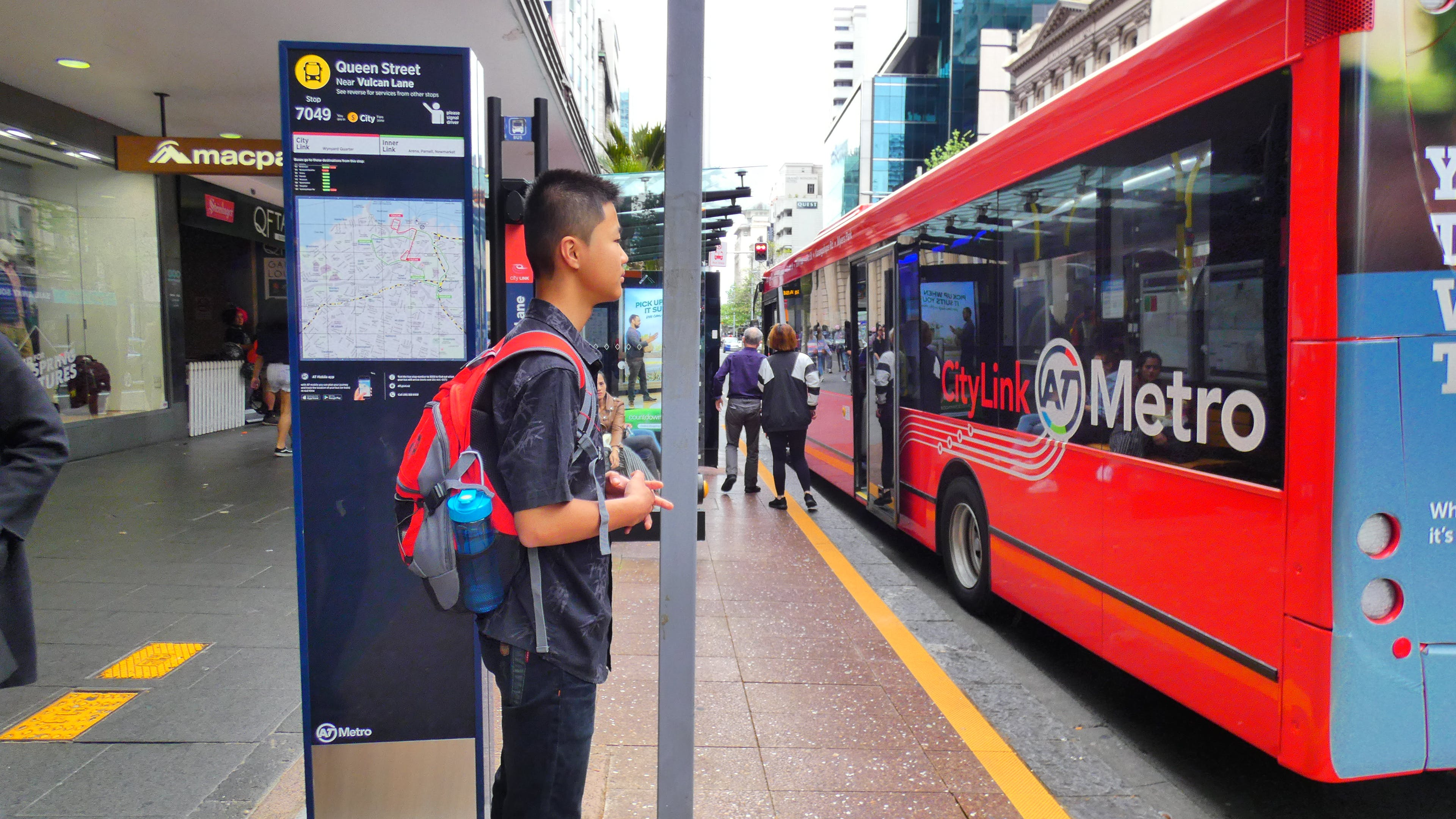 Free stock photo of bus, bus stop, city center, teenager
