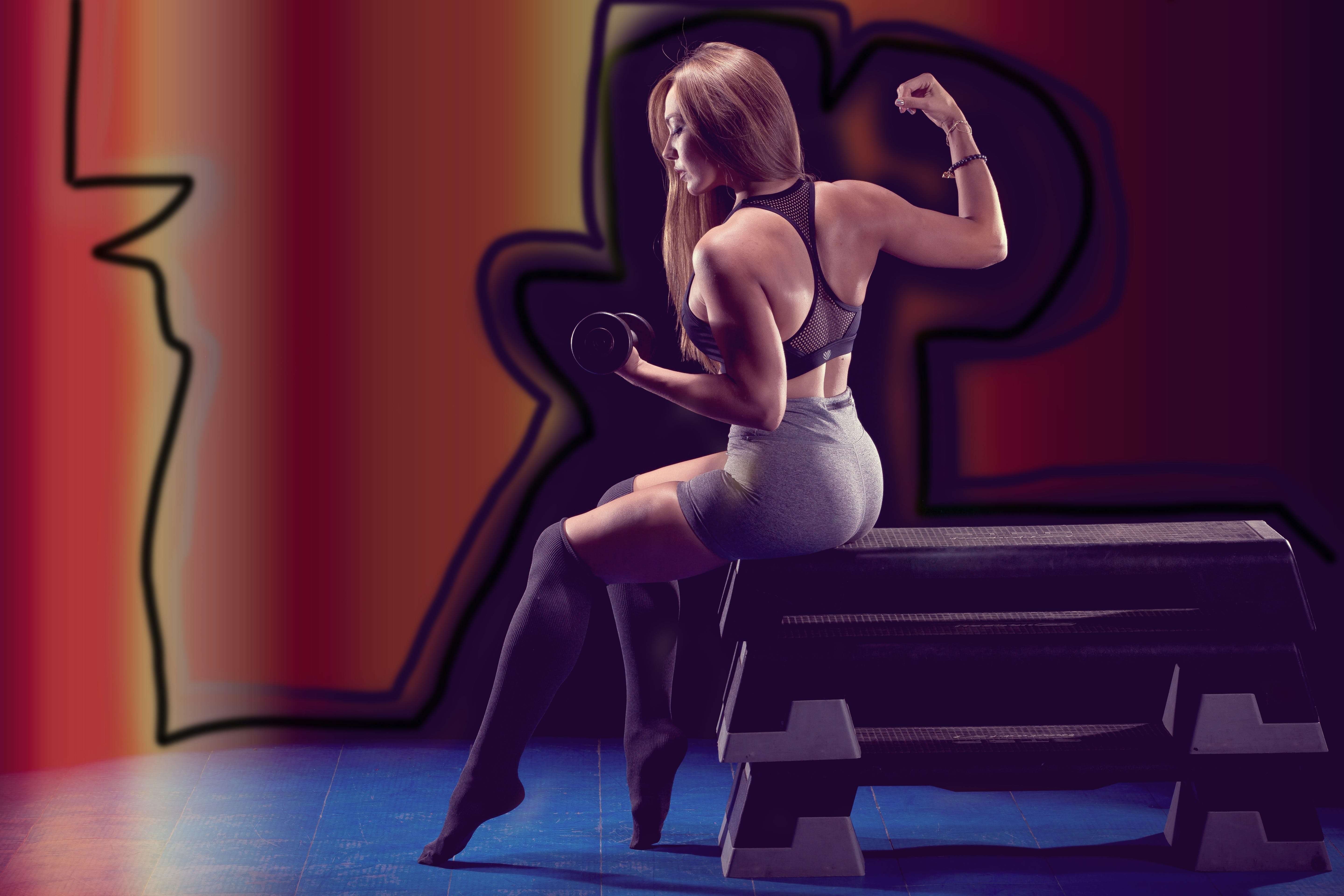 Photo of Woman Lifting Dumbbell
