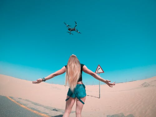 Black Quadcopter Over Woman Wearing Black Shirt