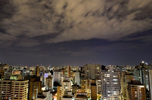 Aerial View of City With High Rise Building at Night Time