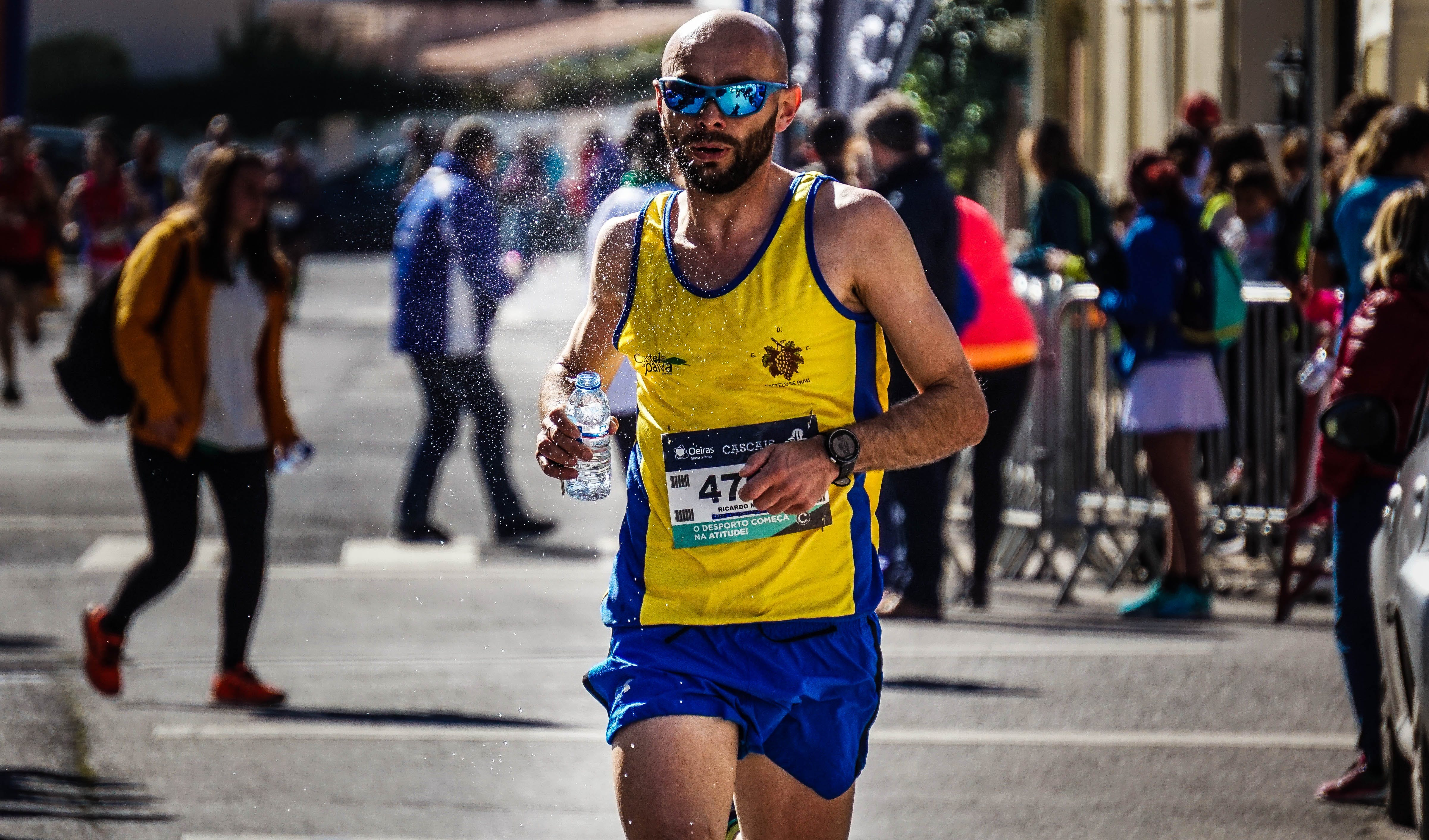 Man in Yellow and Blue Tank Top Running