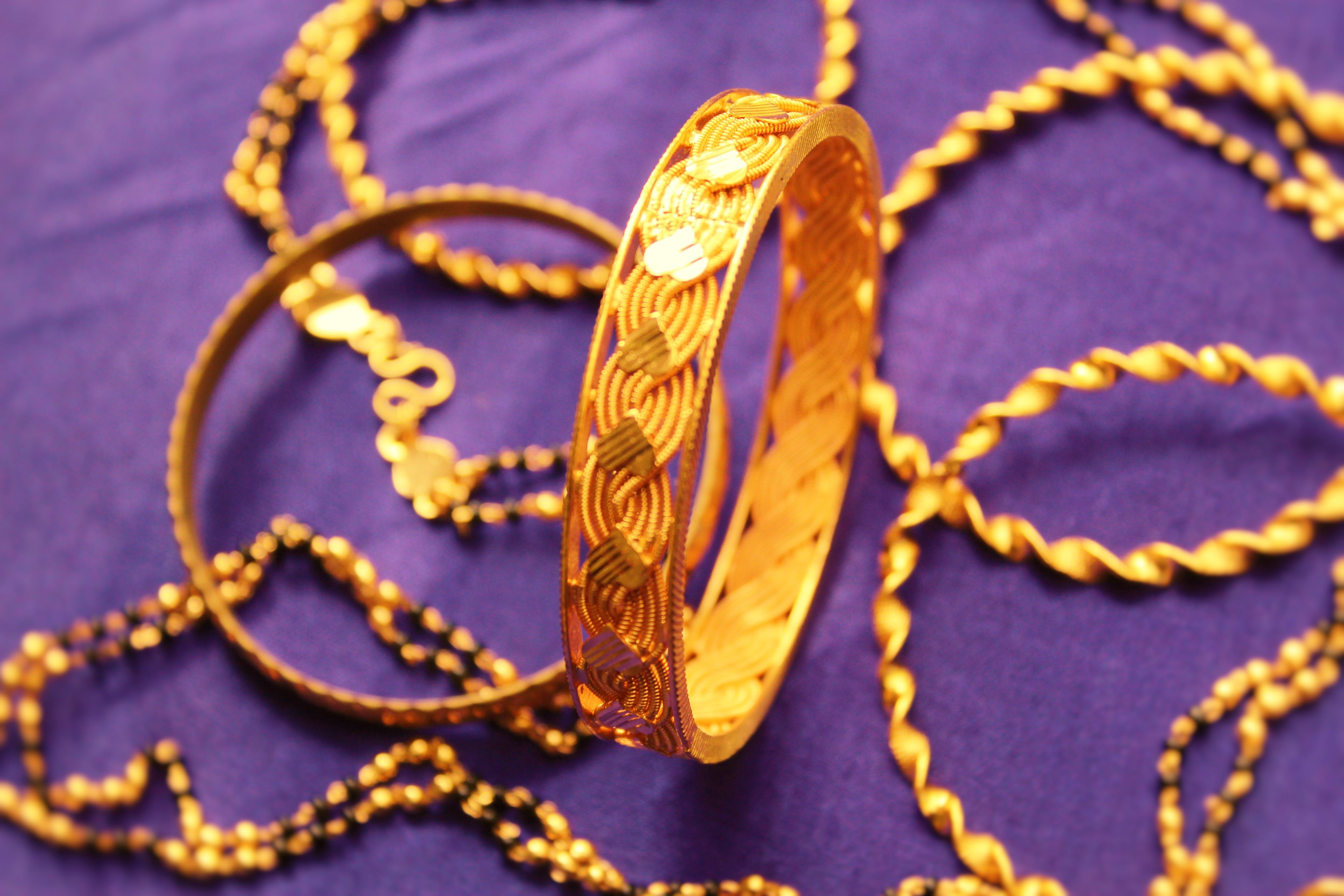 Free stock photo of bangles, gold, gold bangle, gold ornaments