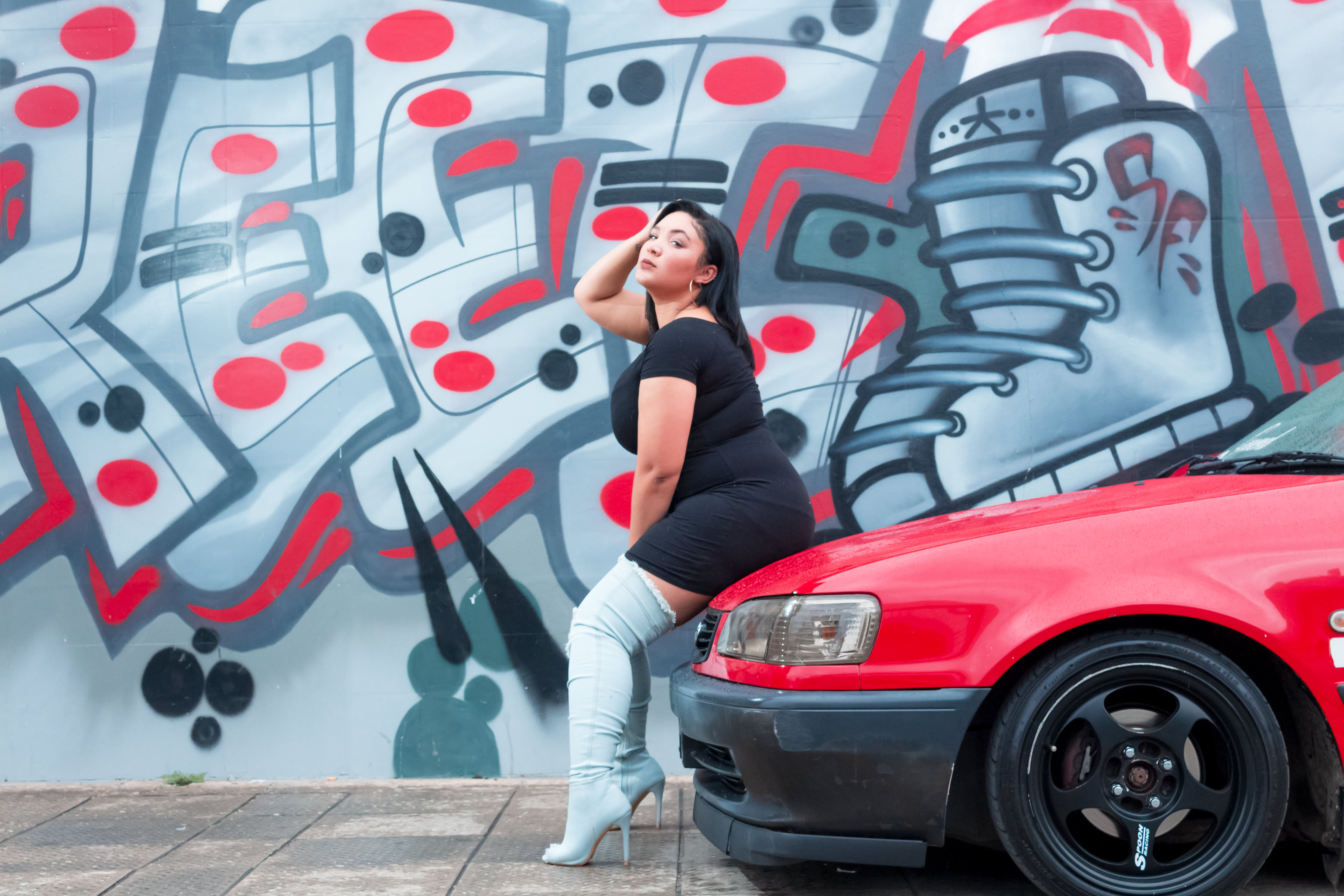 Woman Sitting On Red Vehicle