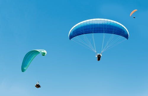 People Riding Para Gliders