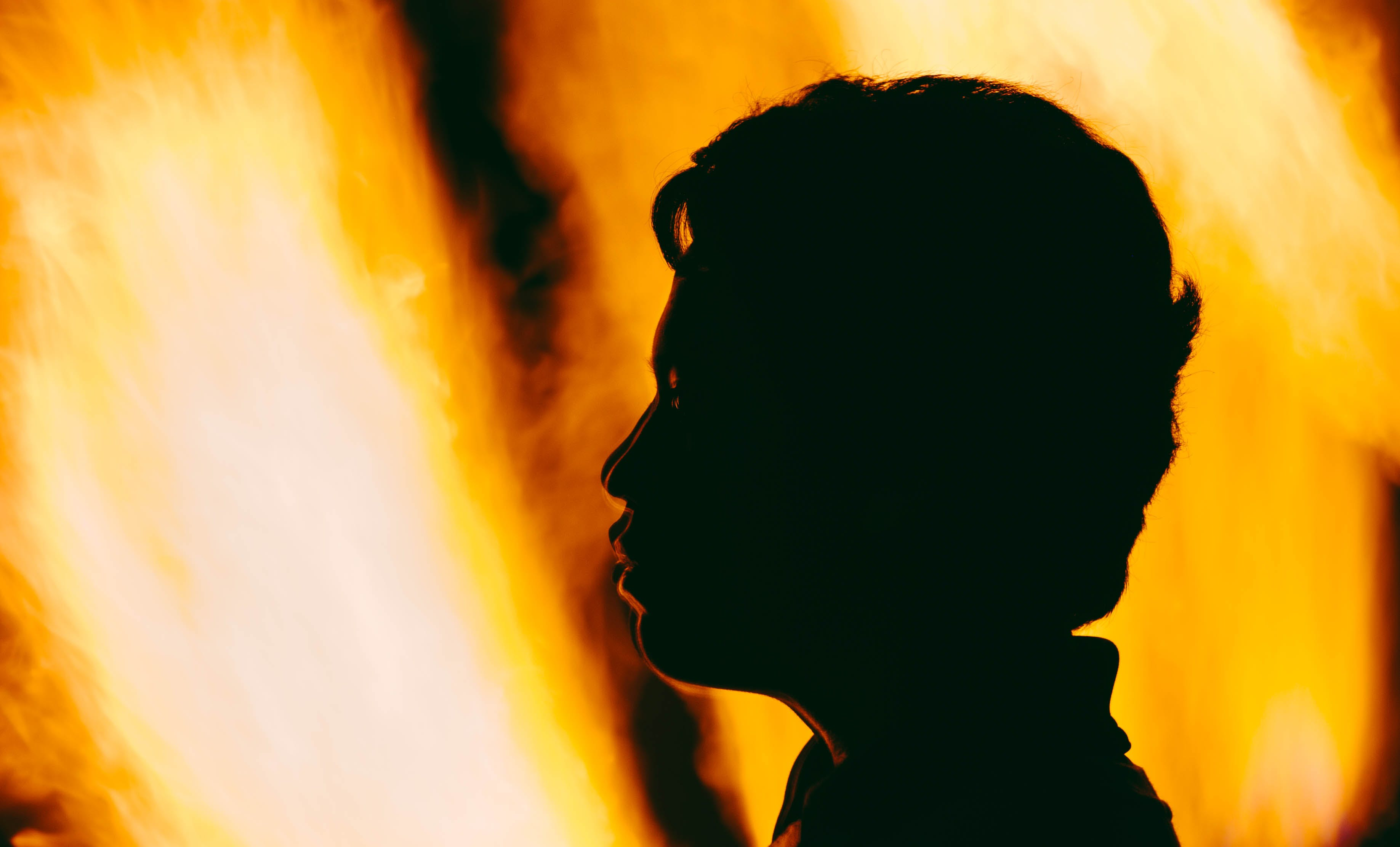 Silhouette With Fire Background