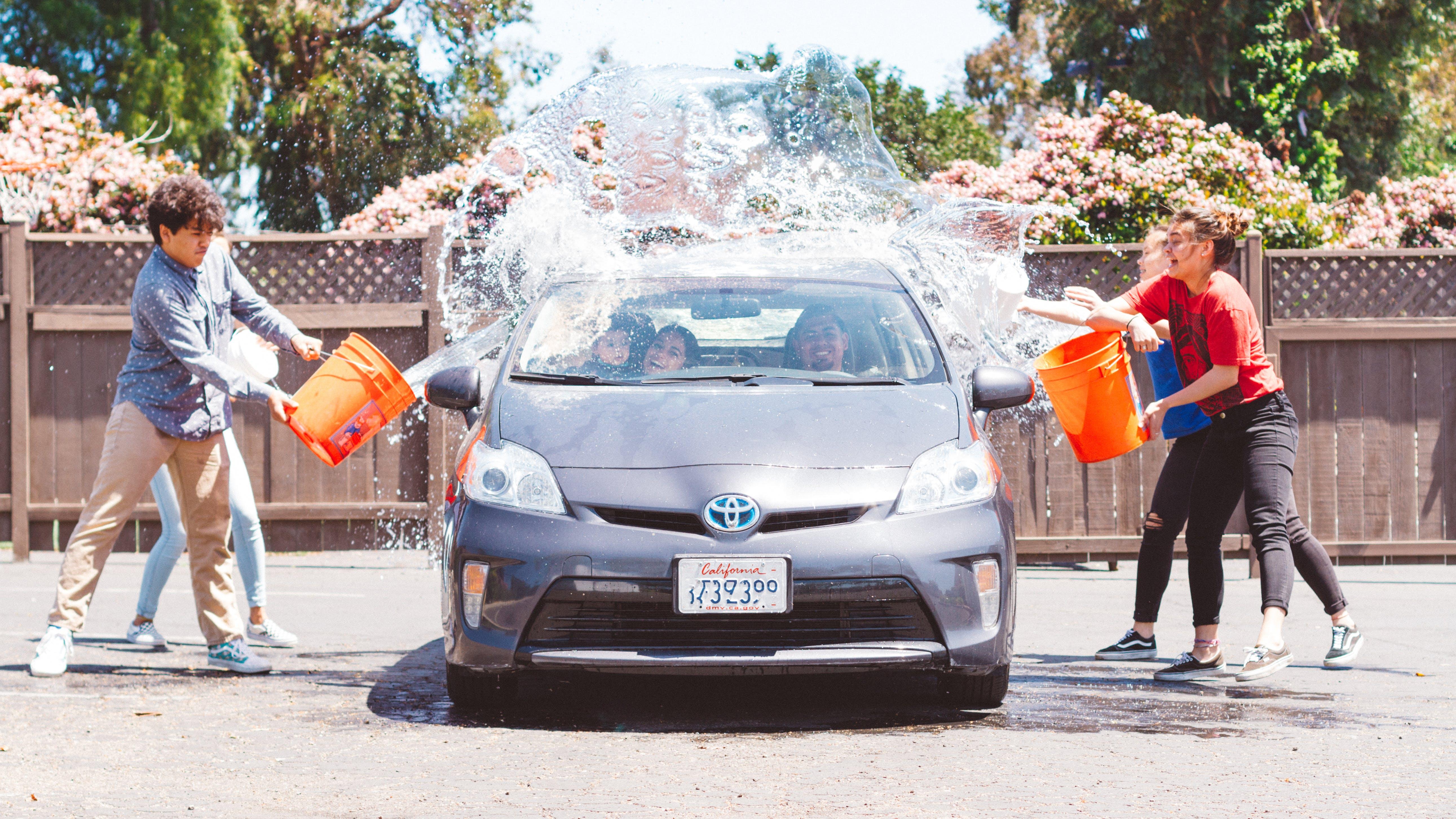 Four Children Washing Silver Toyota Prius